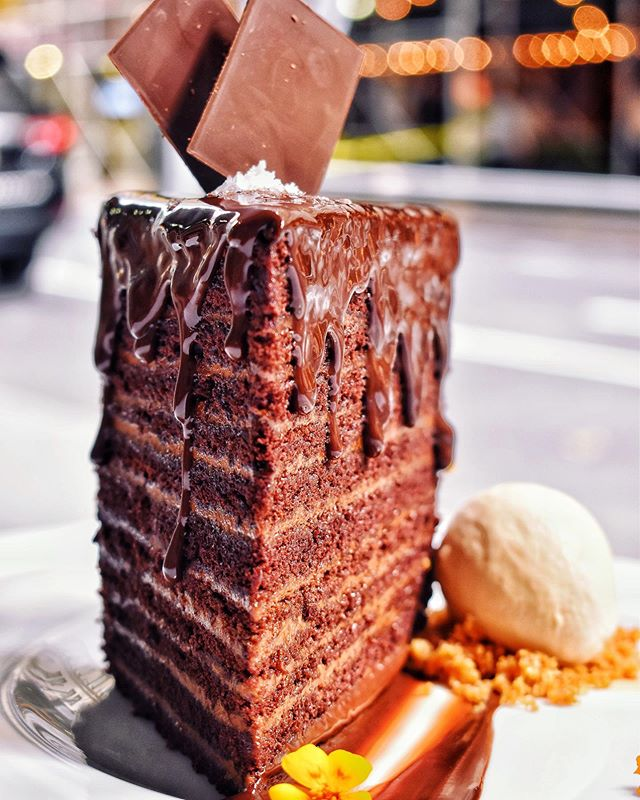 A slice of heaven on the sunny side of the street☀️🍰 #24LayerChocolateCake #HFC