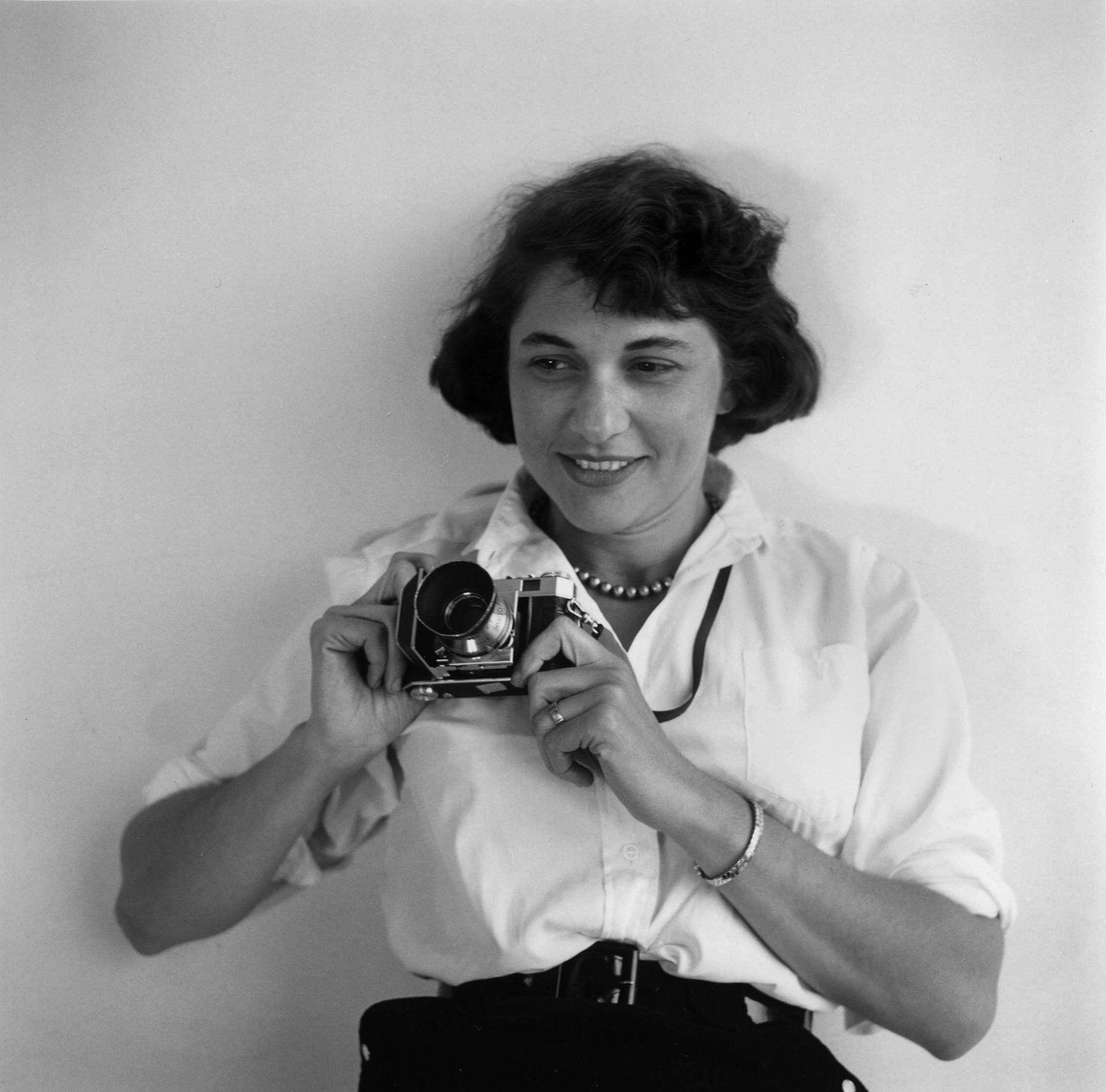 """Ruth Orkin was a photojournalist and filmmaker. She is best known for her images of celebrities, her work with LIFE magazine covering the Israeli Philharmonic, and her project """"Don't Be Afraid to Travel Alone"""" about women traveling alone in Europe after WWII.  © Orkin/Engel Film and Photo Archive"""