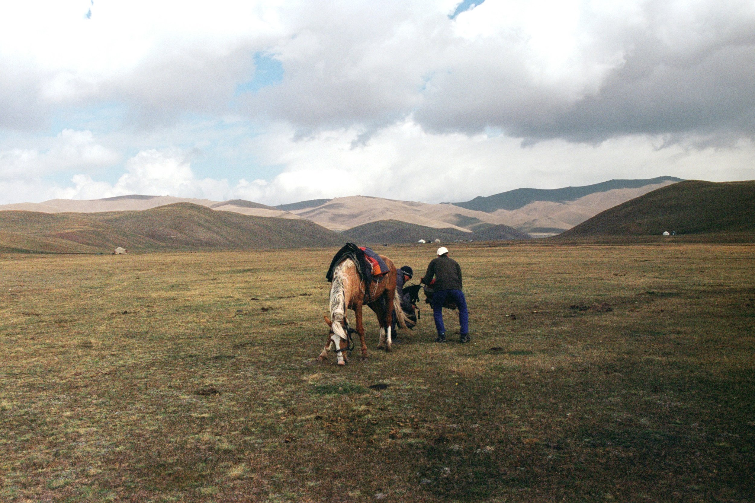 Finally we make it to Son Kul, Ralph and our guide take down our backpacks from the horses.