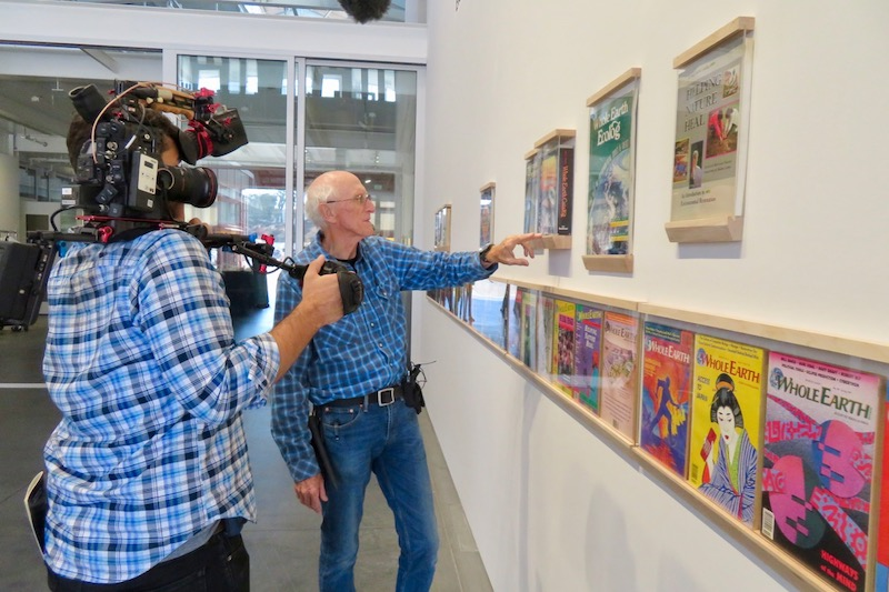 Stewart Brand shows a full collection of Whole Earth publications on display at the event. Photo by    Fabrice Florin   .