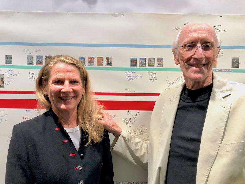 Organizers Ryan Phelan and Stewart Brand pose for one last photo in front of a 50-year timeline of the Whole Earth Catalog's long history. Photo by    Fabrice Florin   .