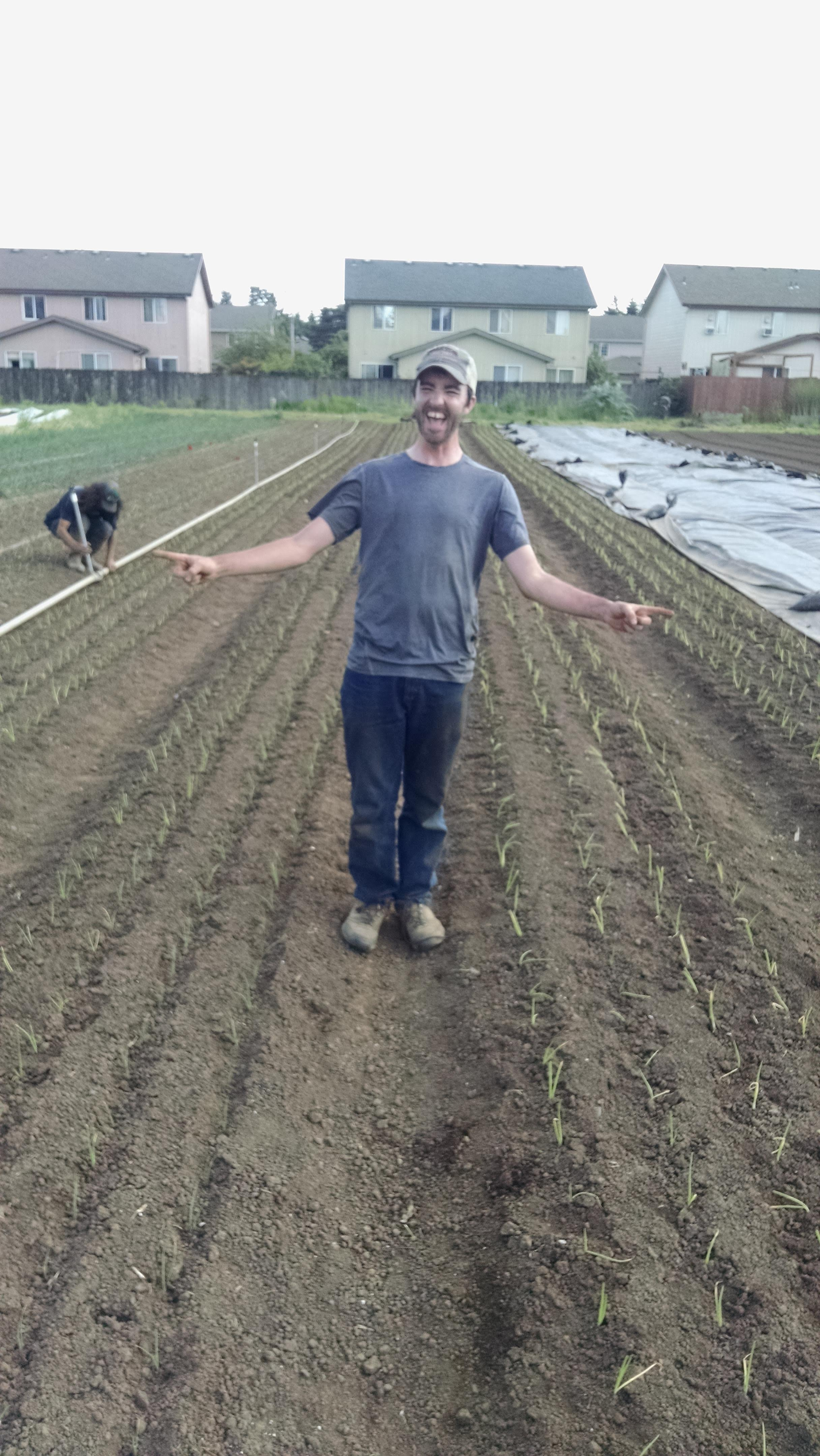 Phil celebrating the end of onion planting for the day