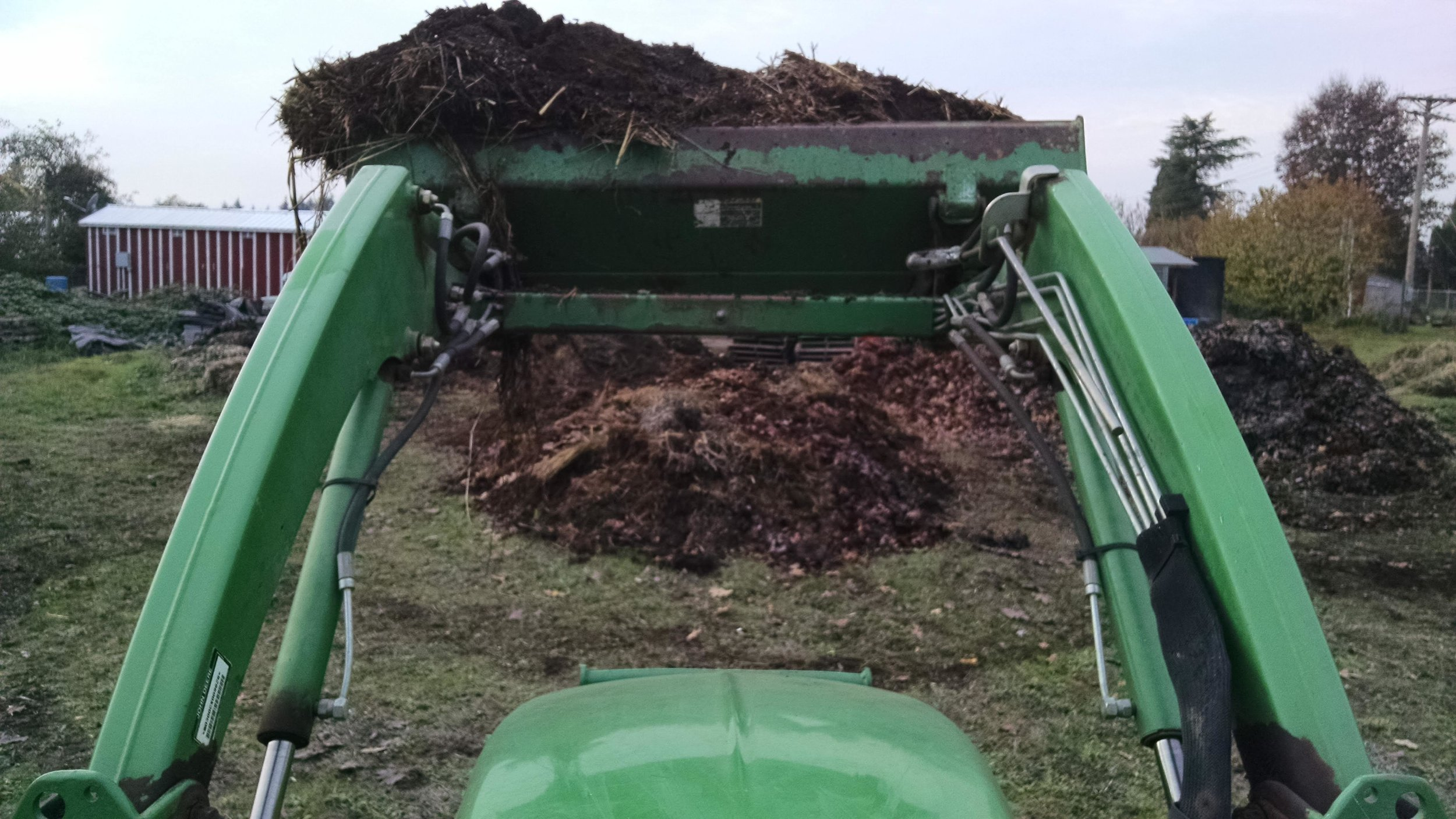 In my happy place, making a giant compost pile