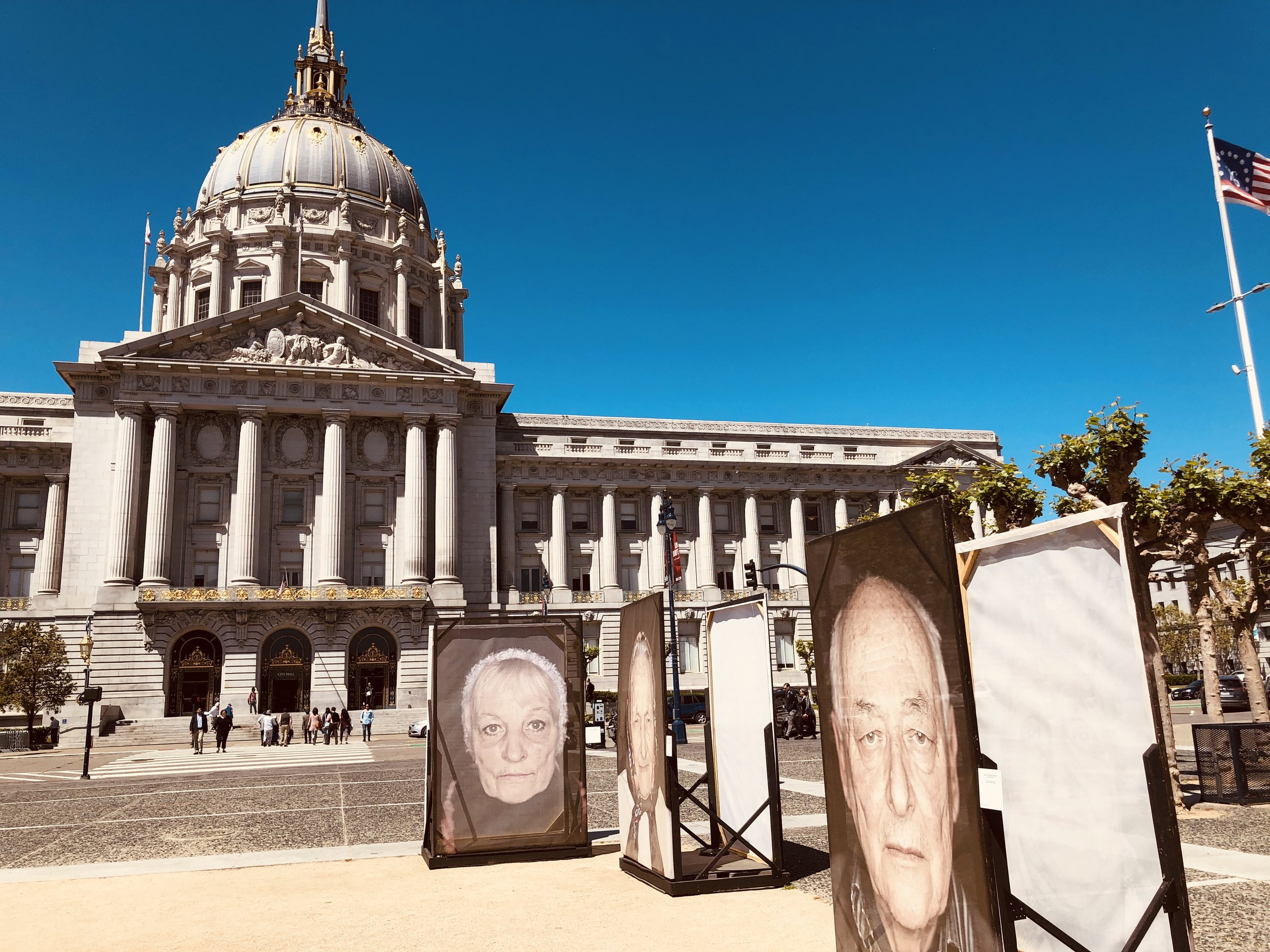 """San Francisco's City Hall, the backdrop of the exhibition, """"Lest We Forget."""""""