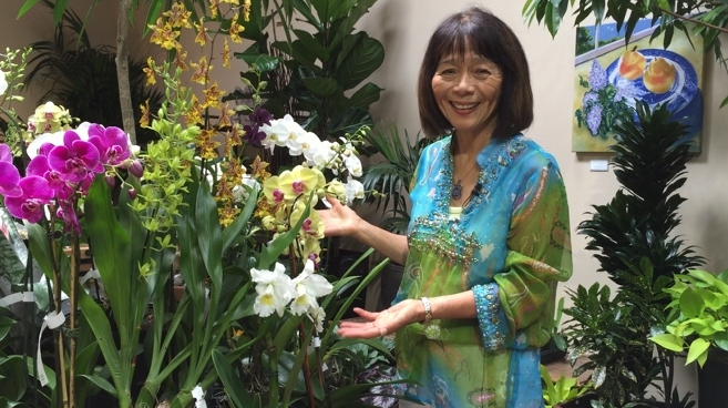 Kifumi with orchids in shop.jpg