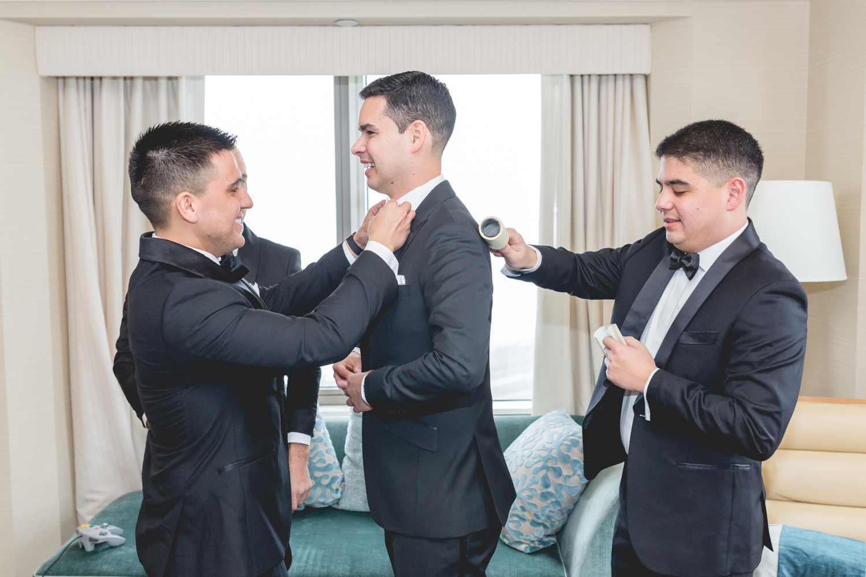 groom_groomsmen_gettingready_loewswedding_sfcityclubwedding_0119_OutOfTheBooth-37.jpg
