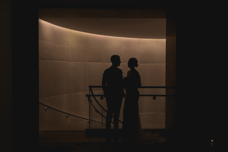 weddingcoupleportrait_silhouetteportrait_loewswedding_sfcityclubwedding_0119_OutOfTheBooth-48.jpg