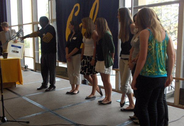 Burl Toler presenting Most Improved (GPA average) award to the Cal Women's Golf Team.