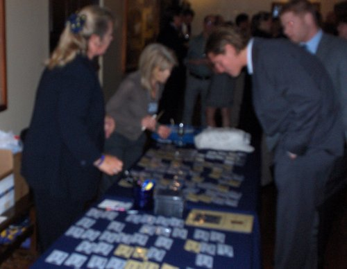 Lynn Lippstreu and Peggy Carpenter working the name tags. (Picture is blurry due to the speed at which the girls are moving!)