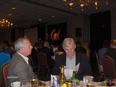 While Don speaks (background), Mike Gridley reads menu to Ed Flynn