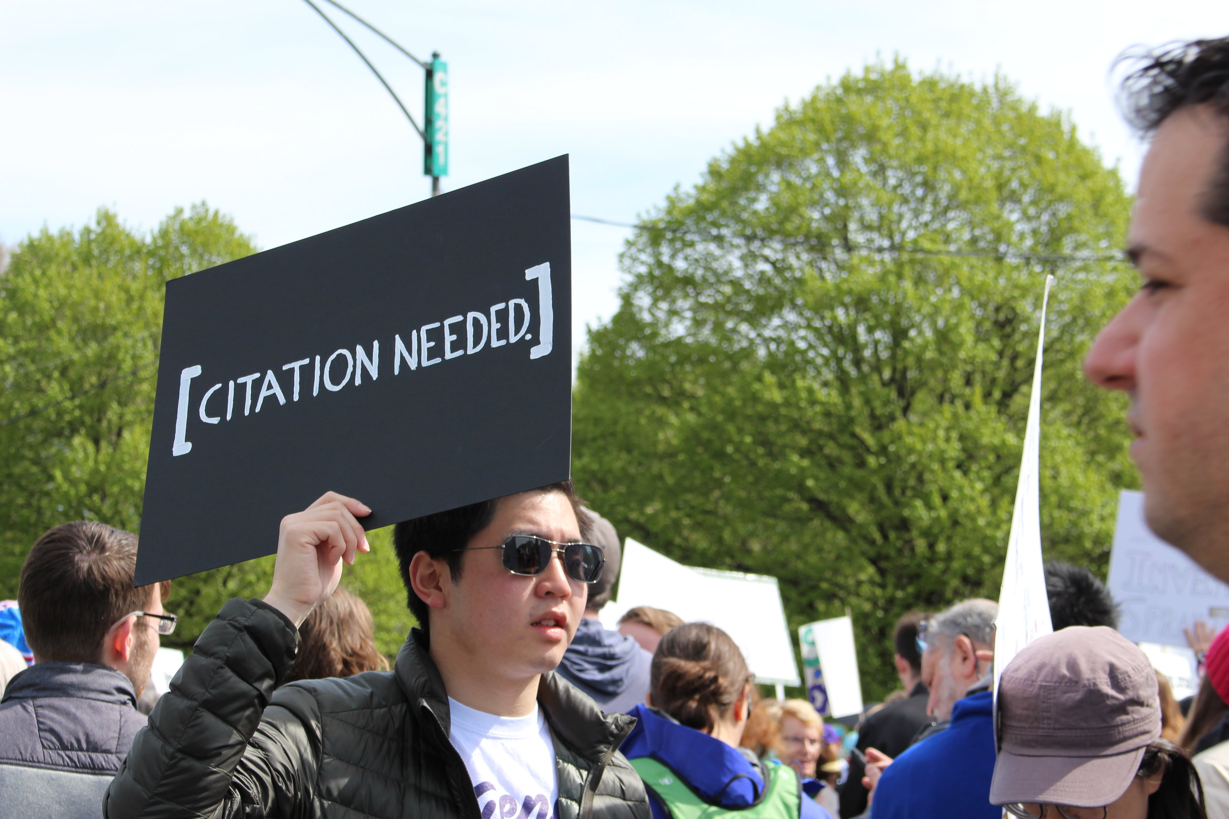 Snarky signs like these made the March for Science more approachable than the Women's March that had happened a month earlier.    Photo by Audrey Valbuena