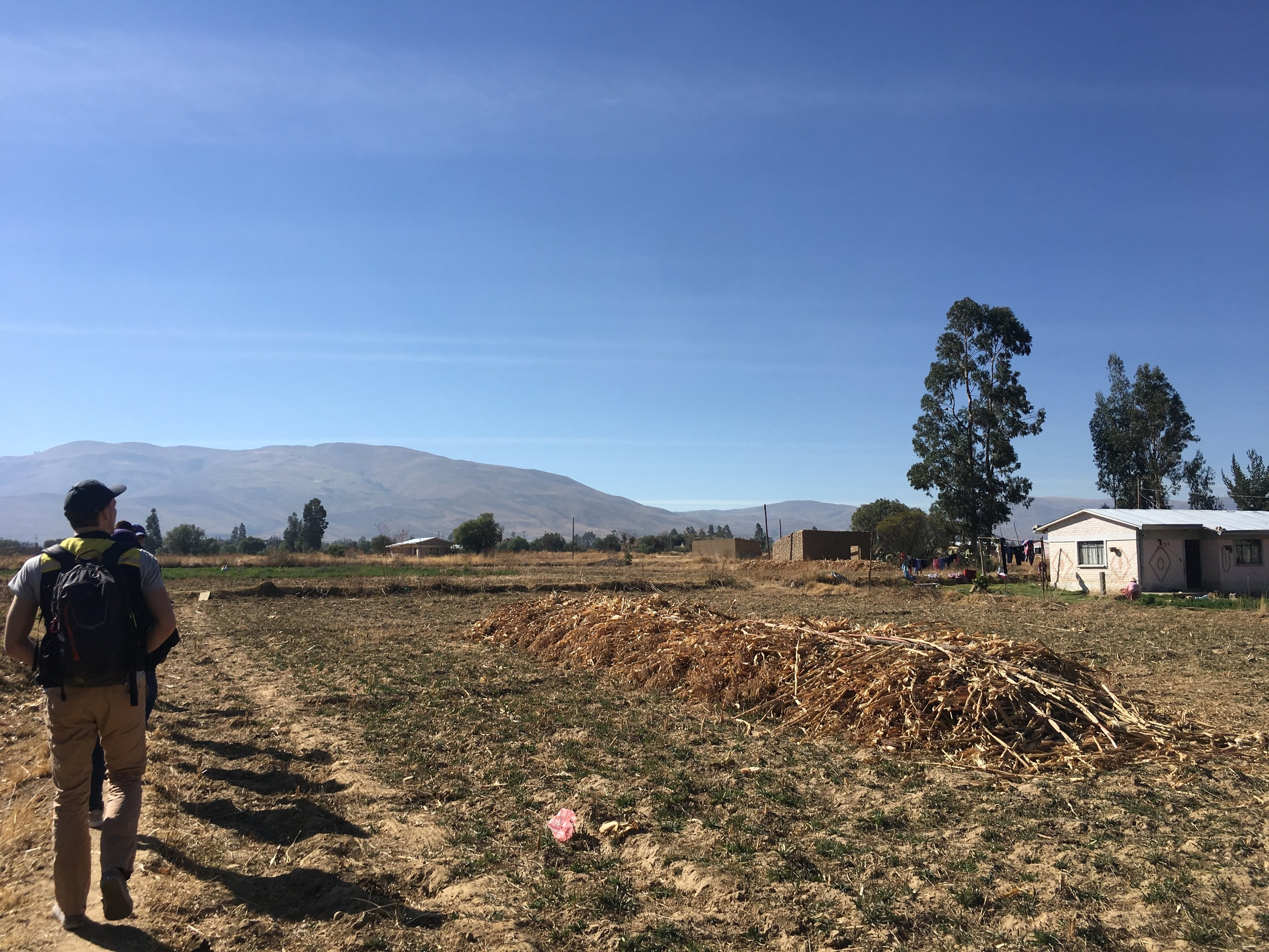 One of my team members, Riley, walking through the campo of Punata .