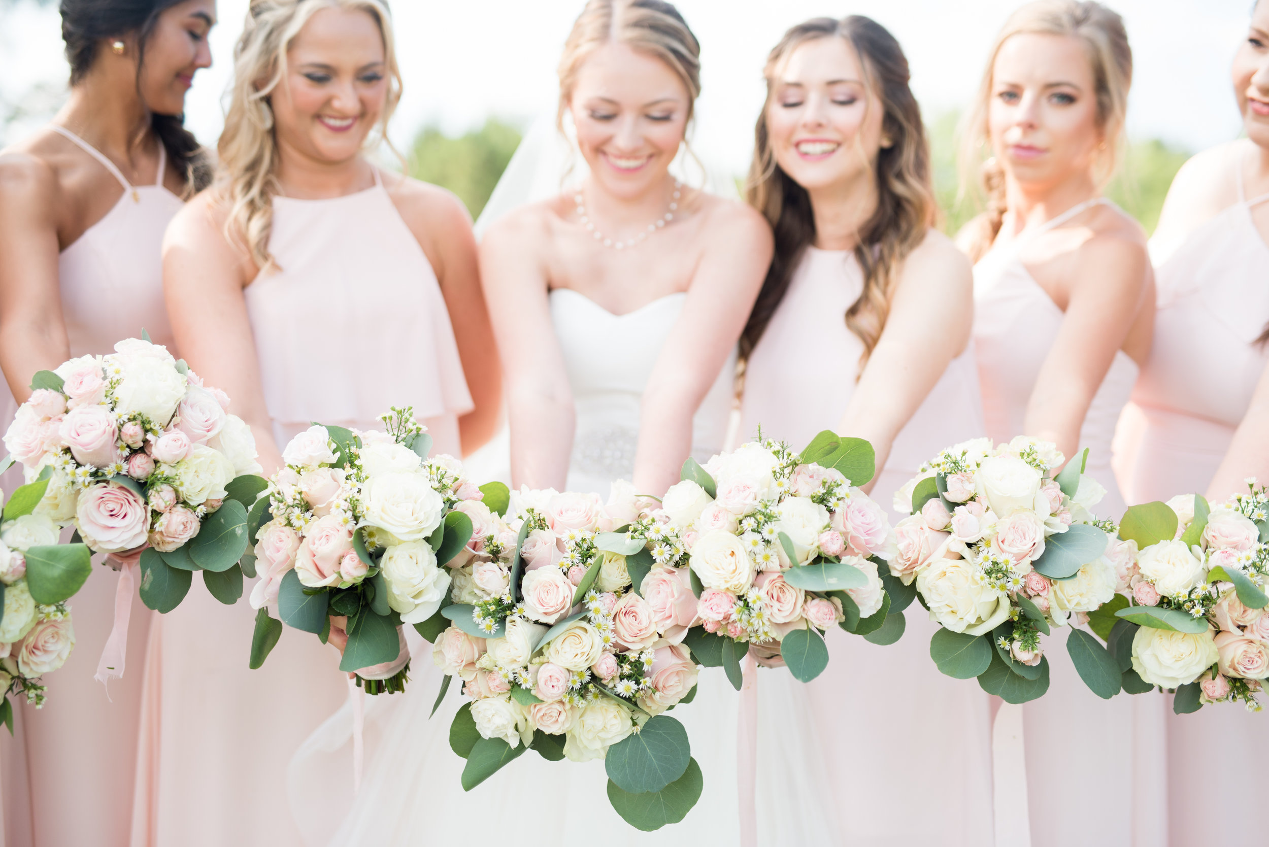 The Barn at Bridlewood wedding in Hattiesburg, Mississippi (MS) in June | Bride and bridesmaids holding wedding bouquets