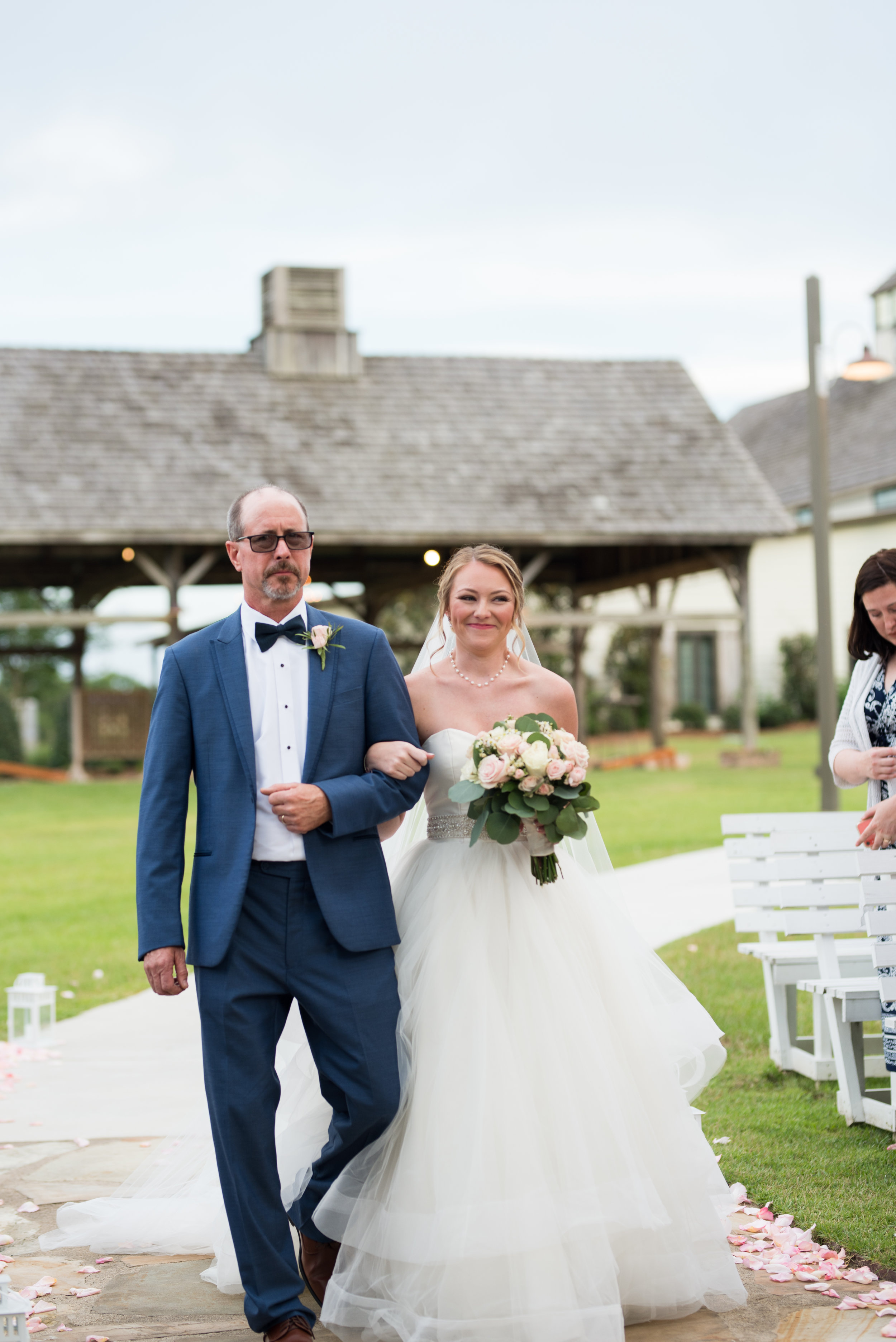 The Barn at Bridlewood wedding in Hattiesburg, Mississippi (MS) in June | Bride and Groom Wedding ceremony bride's emotional first look of her groom standing at the end of the aisle