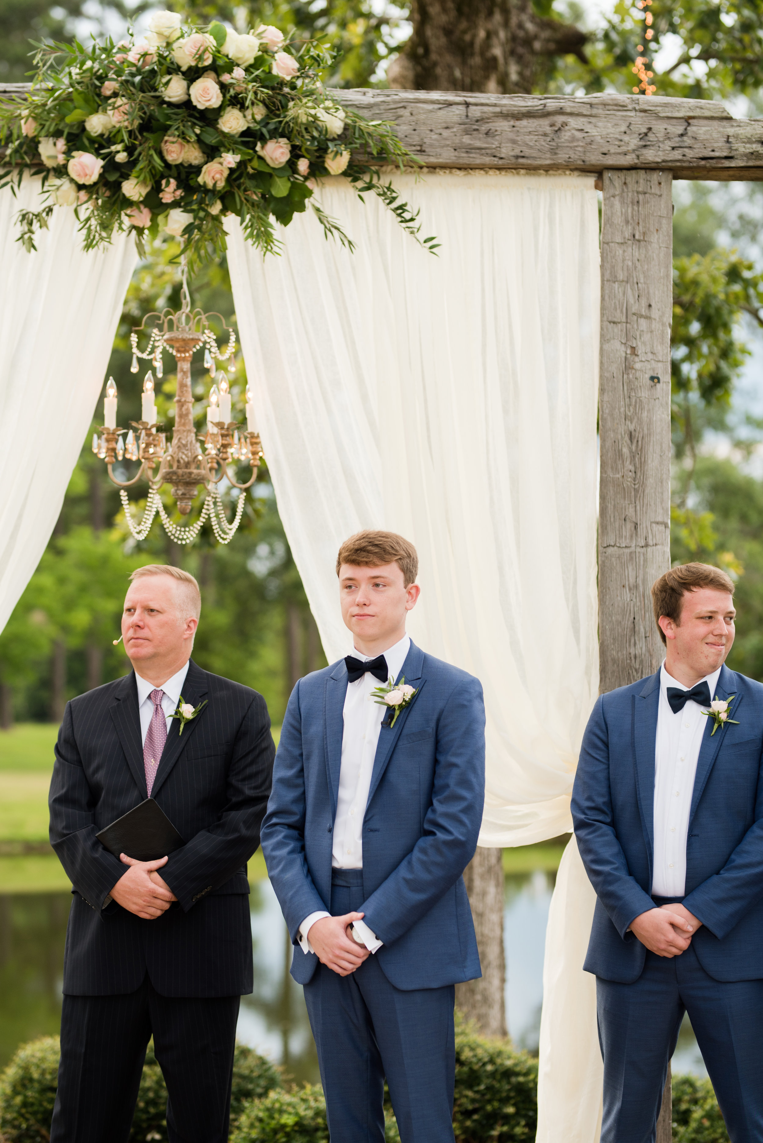 The Barn at Bridlewood wedding in Hattiesburg, Mississippi (MS) in June | Bride and Groom Wedding ceremony groom's emotional first look