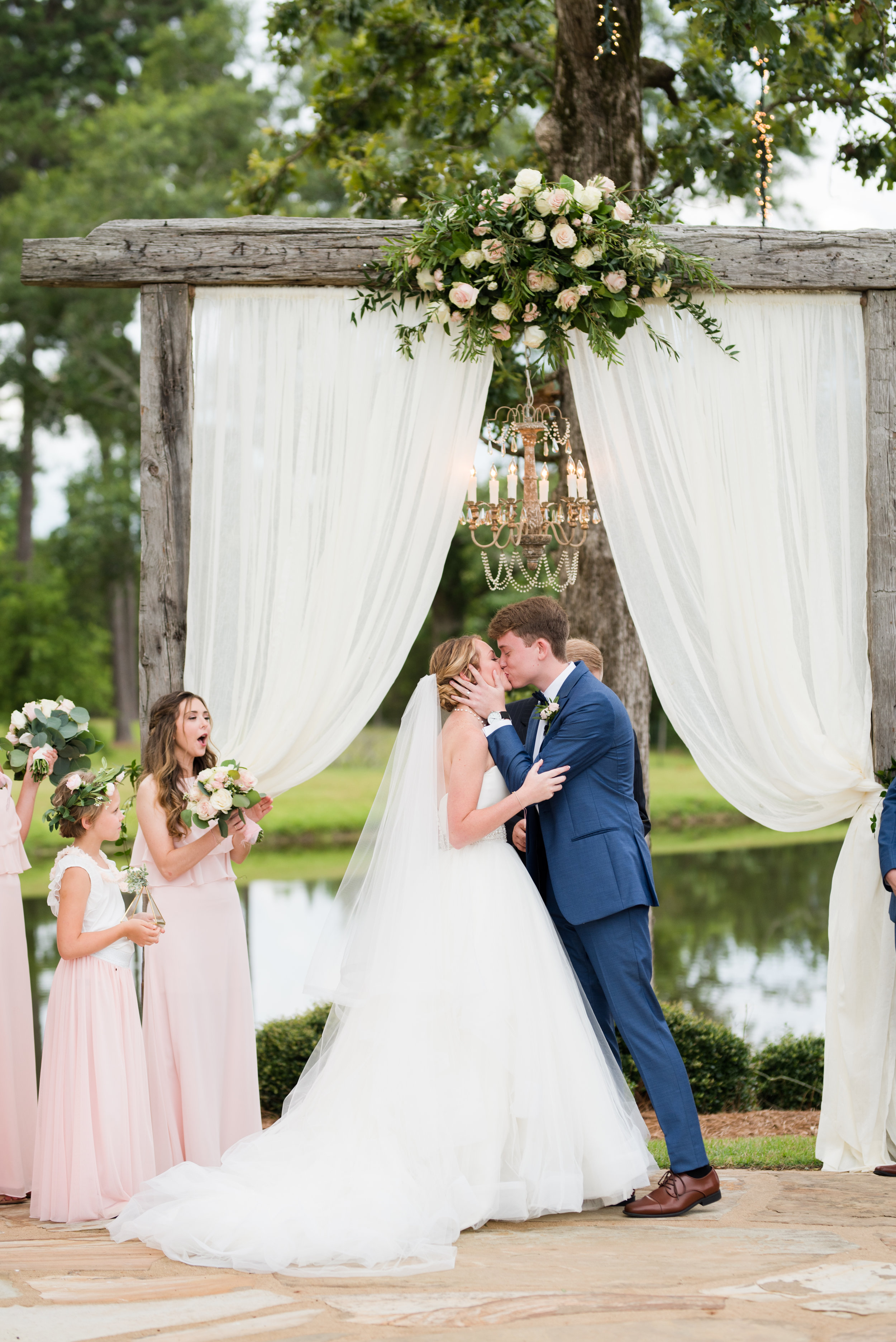 The Barn at Bridlewood wedding in Hattiesburg, Mississippi (MS) in June | Bride and Groom Wedding ceremony first kiss