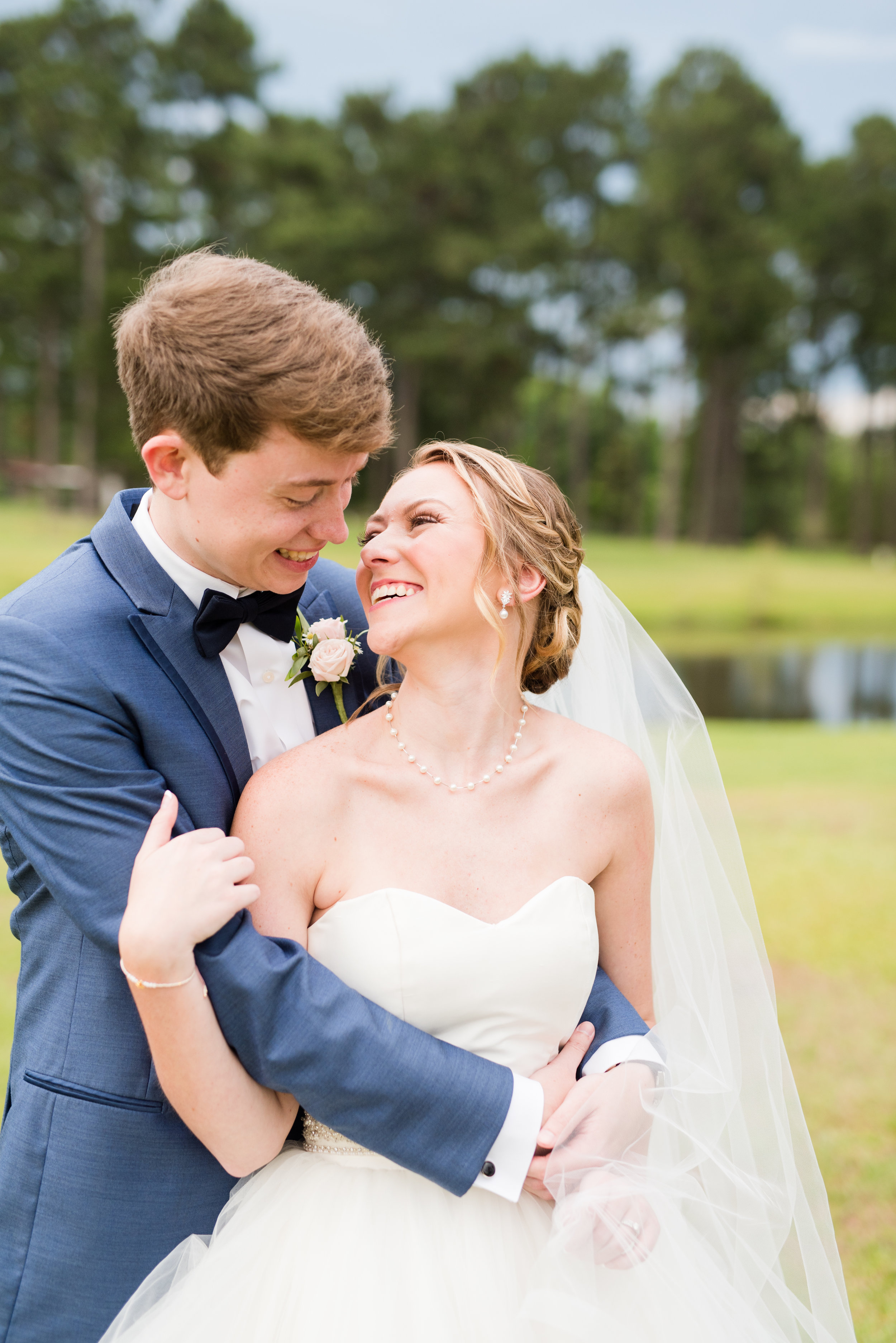 The Barn at Bridlewood wedding in Hattiesburg, Mississippi (MS) in June | Bride and Groom Wedding portraits