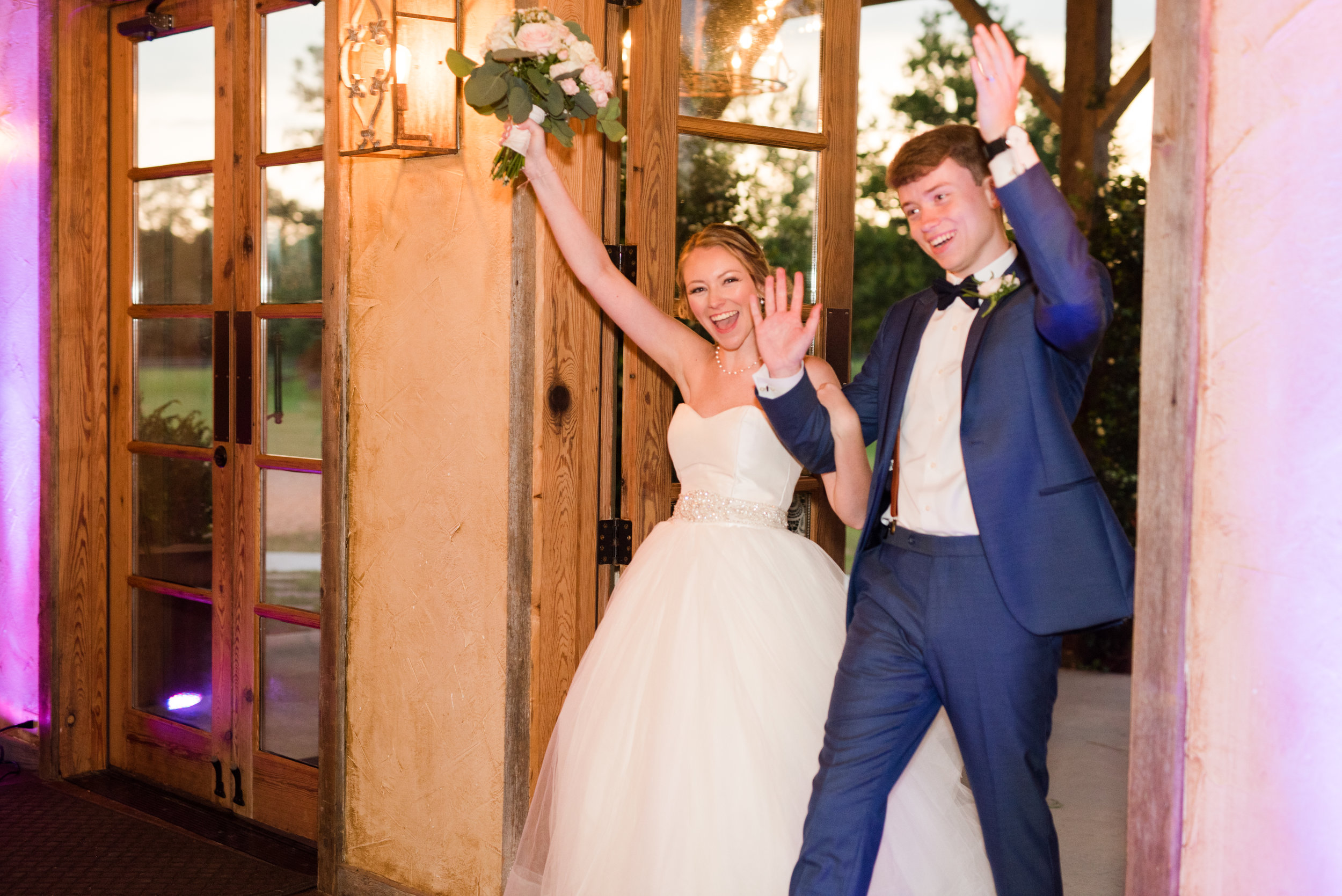 The Barn at Bridlewood wedding in Hattiesburg, Mississippi (MS) in June | Bride and Groom Entering the Wedding