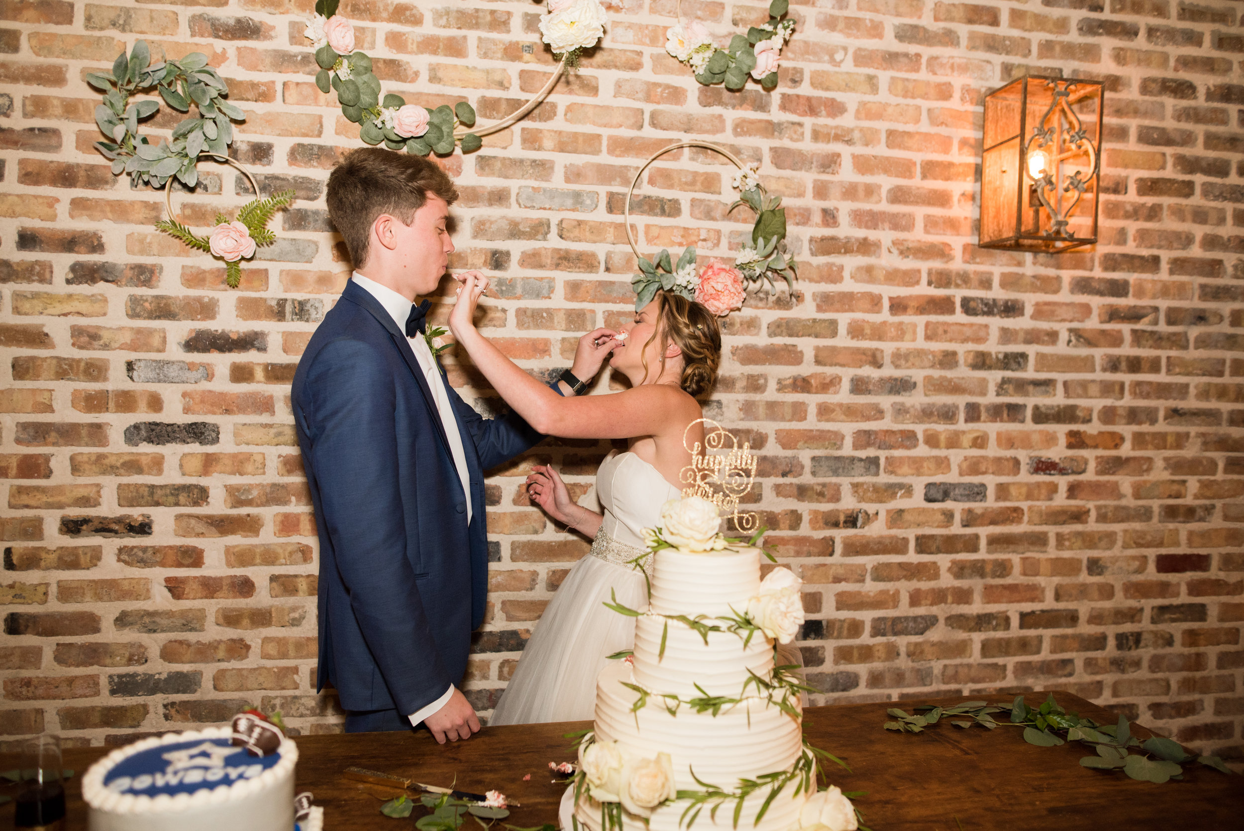 The Barn at Bridlewood wedding in Hattiesburg, Mississippi (MS) in June | Bride and Groom Wedding Cake Cutting, cake smashed in faces