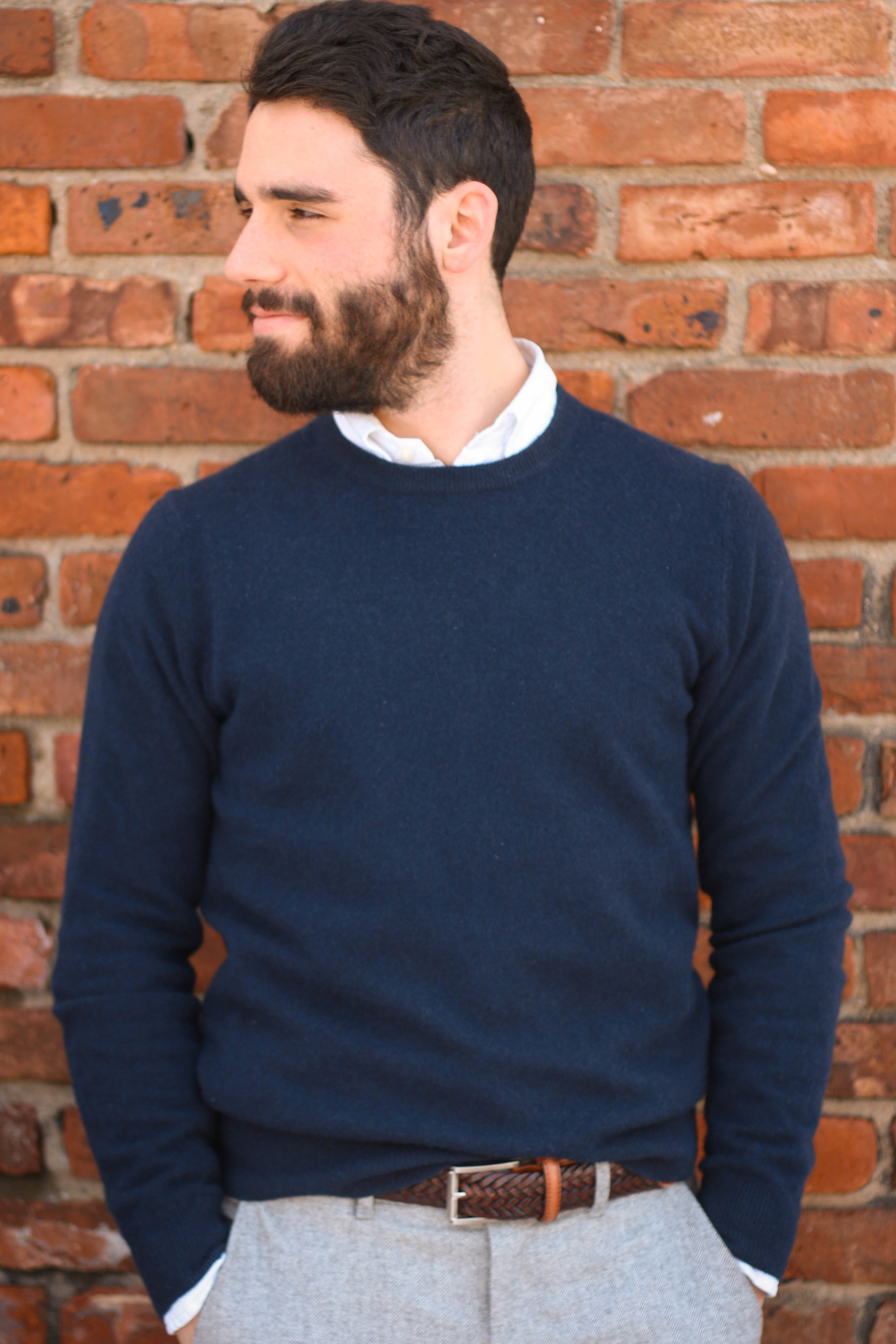 The cashmere sweater is shown here layered with a Ralph Lauren white oxford shirt and will blend flannel trousers from Gap