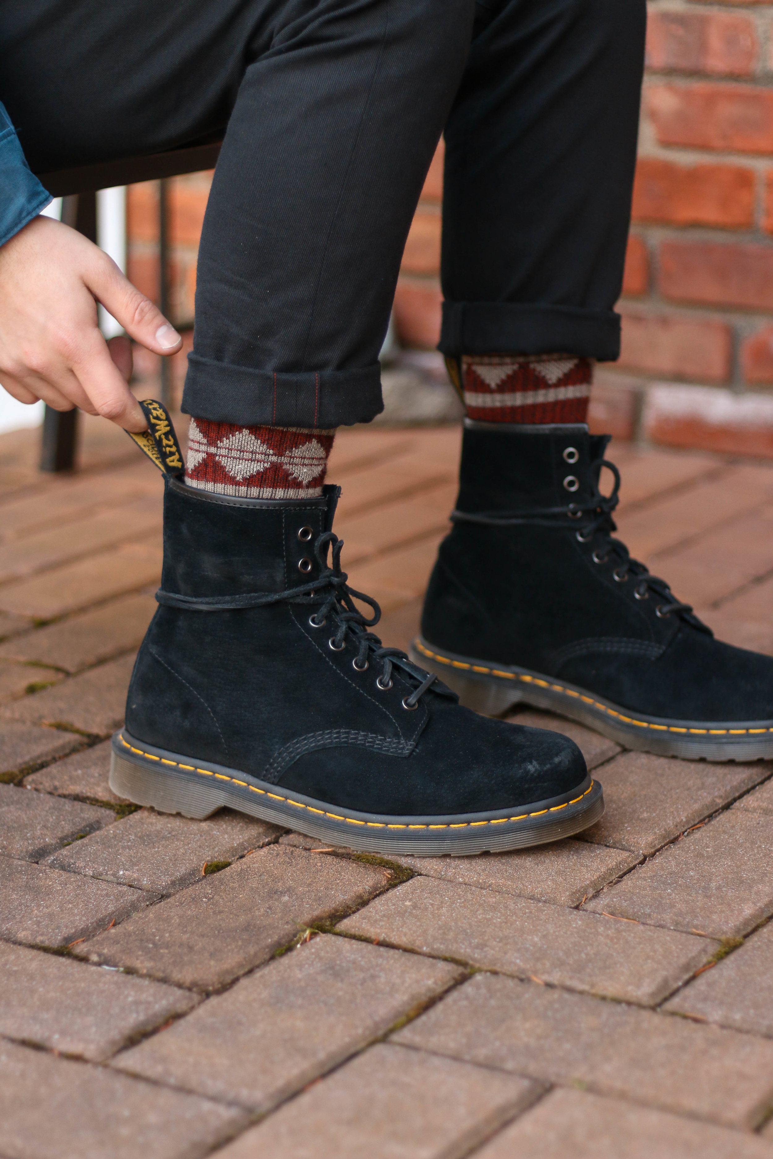The fit on these is big and loose. It 'doesn't hug the foot vs my Red Wing Heritage boots which fit like a glove.