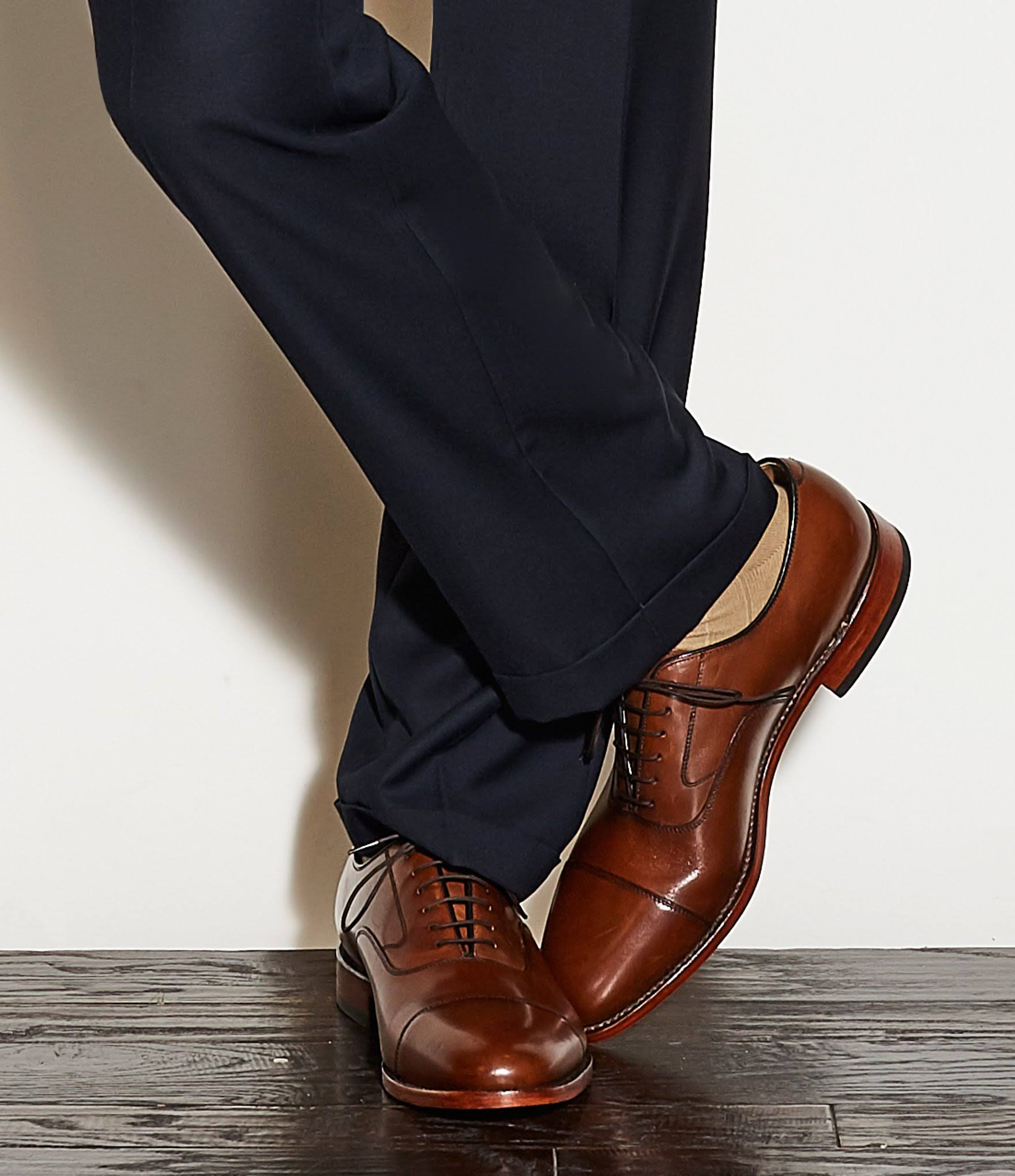 The Melton captoe oxford from Johnston and Murphy offers the best value in goodyear welted shoes. These are not styled by the Mensch - you should know this from the baggy, and too long, pants along with the wayyyy to big sizing on this poor fellah!