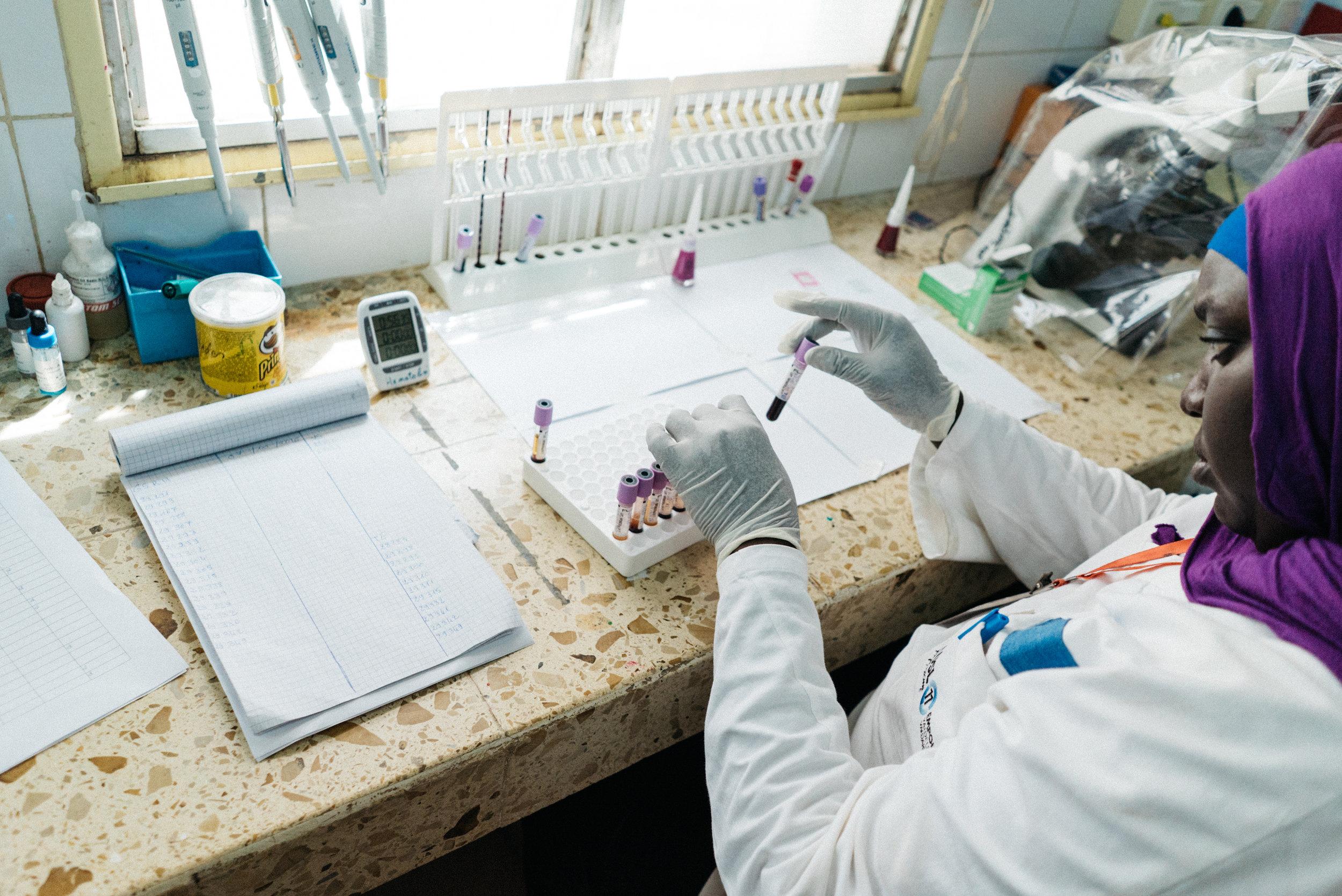woman test tubes data senegal