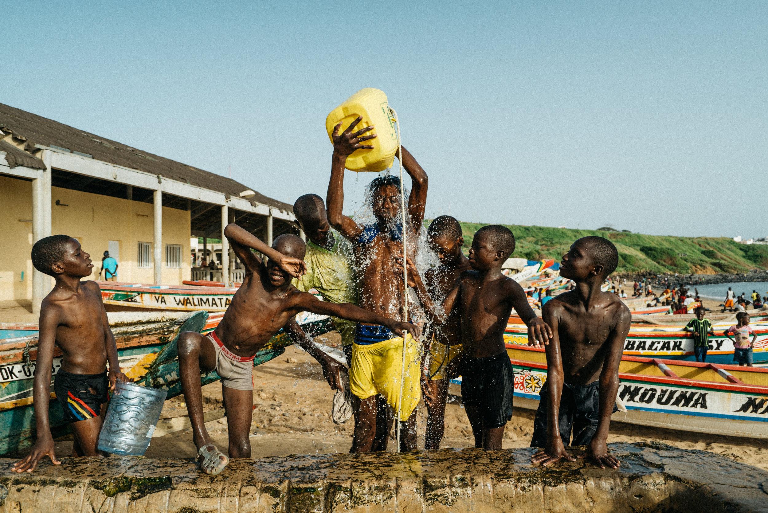 boys playing water senegal
