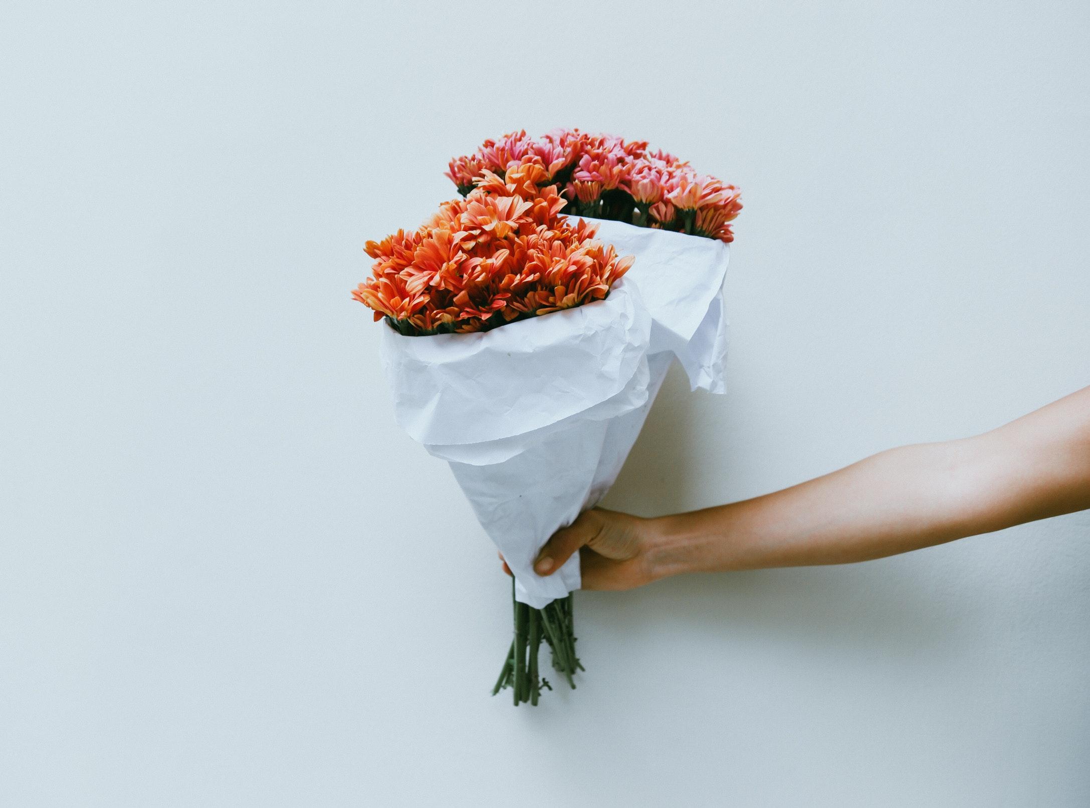 flowers being held out.jpg