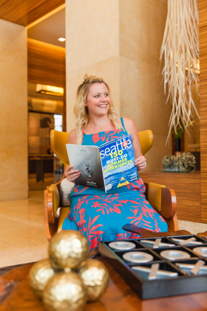 Reading all about the Seattle hotspots in the cute lobby!