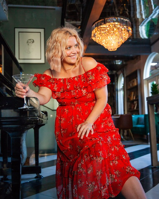 Sipping a martini in their fantastic lounge wearing fall line:  Zara!     DRESS: $69.90