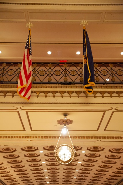 Flags decorate the main balcony in the lobby and I adore that hanging clock.