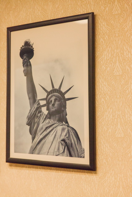 A picture of Lady Liberty hangs in the hallway.