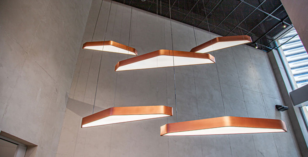 Custom pendant lights are copper paint-finished aluminium with acrylic diffusers