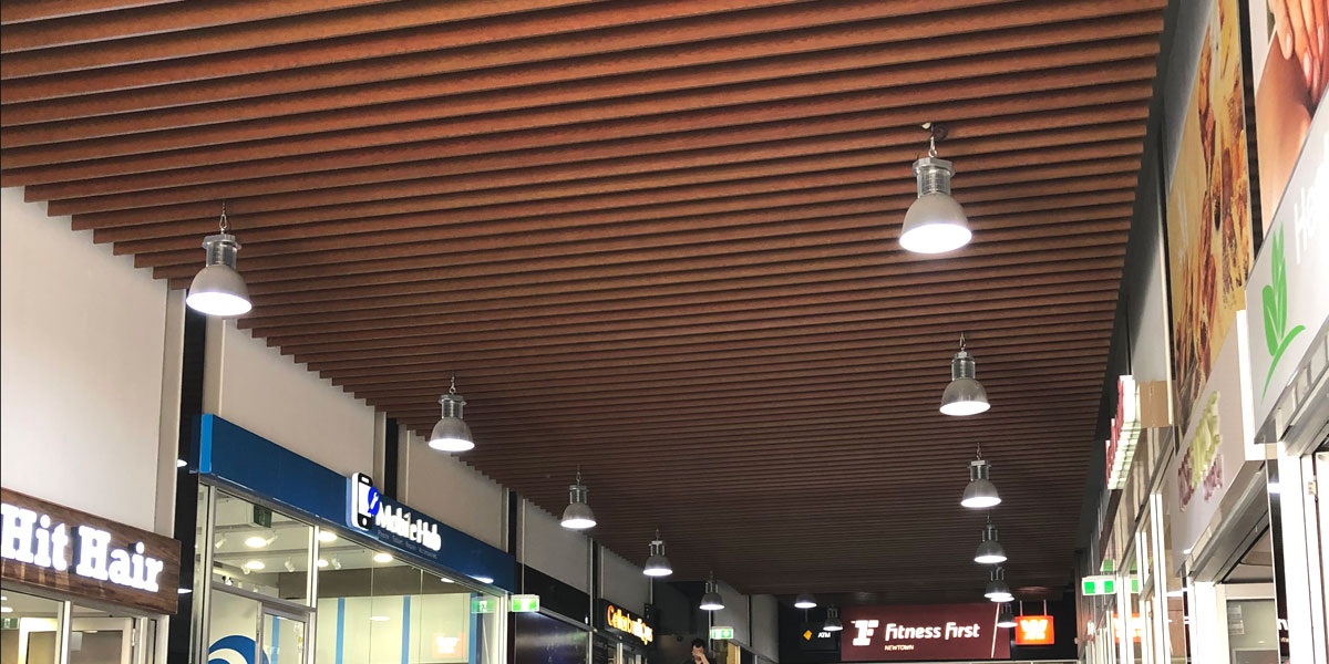 Original ceiling feature of aluminium blades with faux wood finish
