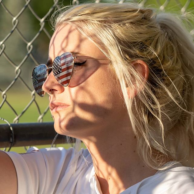 Summer vibes at the softball field. . . . . . #baseball #softball #summer #sunset #girl #summer2019 #shadow #sunglasses #flag #usa #ctctlife #sunny #sunshine #green #grass #fence #jersey #america #sony #sonyalpha #sonyalphagang #sonya7iii #sony24105mm #colorado #coloradophotographer #lovelandphotographer #fortcollinsphotographer #boulderphotographer #denverphotographer #vividmatter