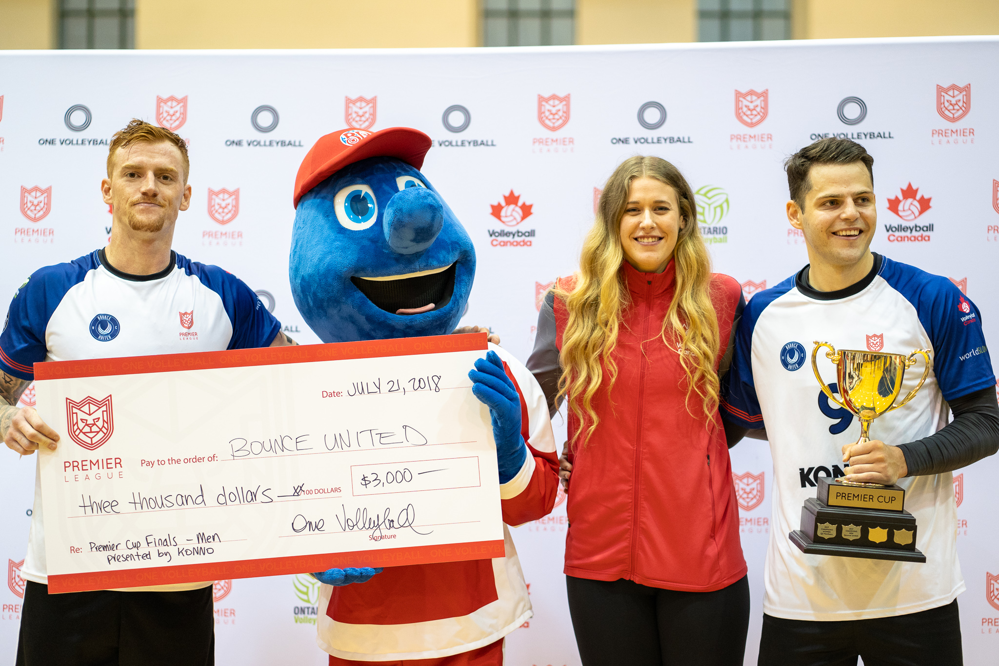 Men's Champions - Bounce United Trophy presented by Jen Cross (Team Canada) and cheque presented by Boston Pizza to team captains Steve Hunt and Aleksa Miladinovic