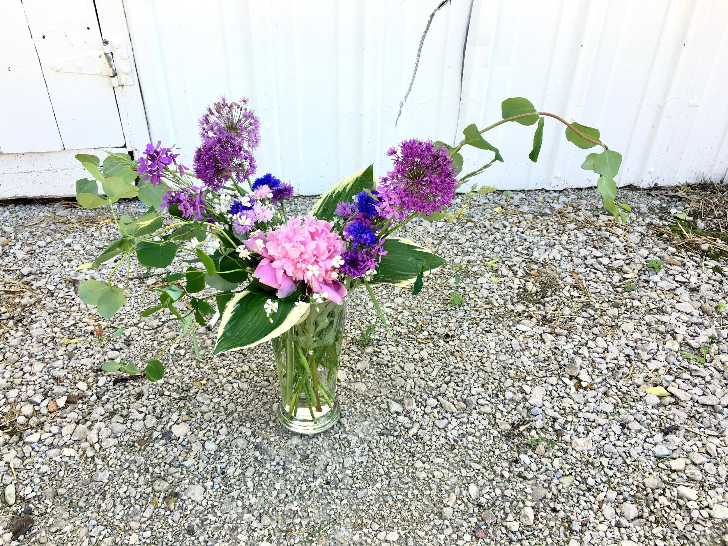 Locally grown and designed sympathy flowers.