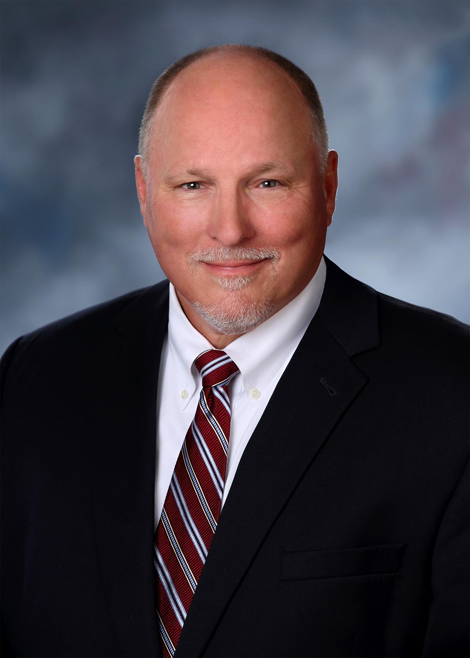 Mark E. Dorn, Principal