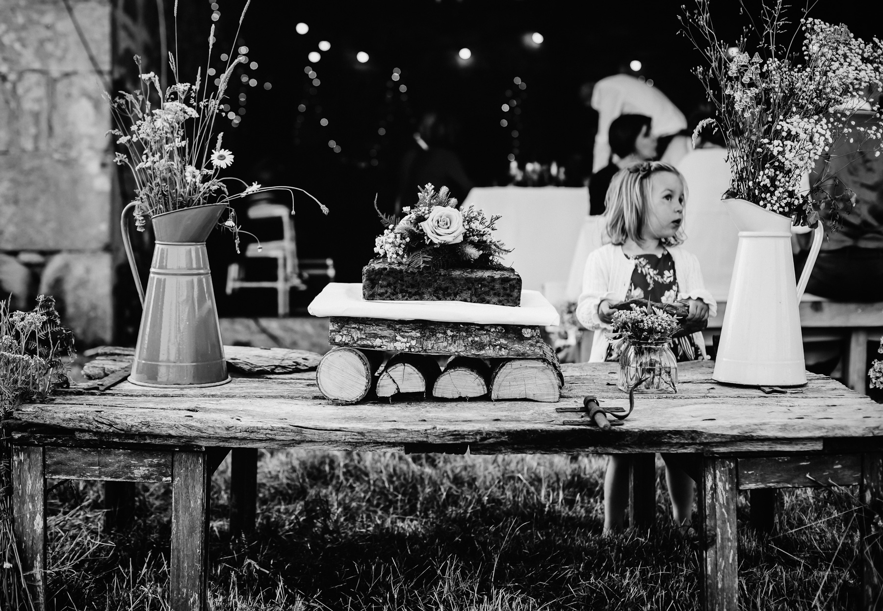Eco wedding in the south of France - homemade fruit wedding cake on a recycled farm table with flowers picked from the fields.
