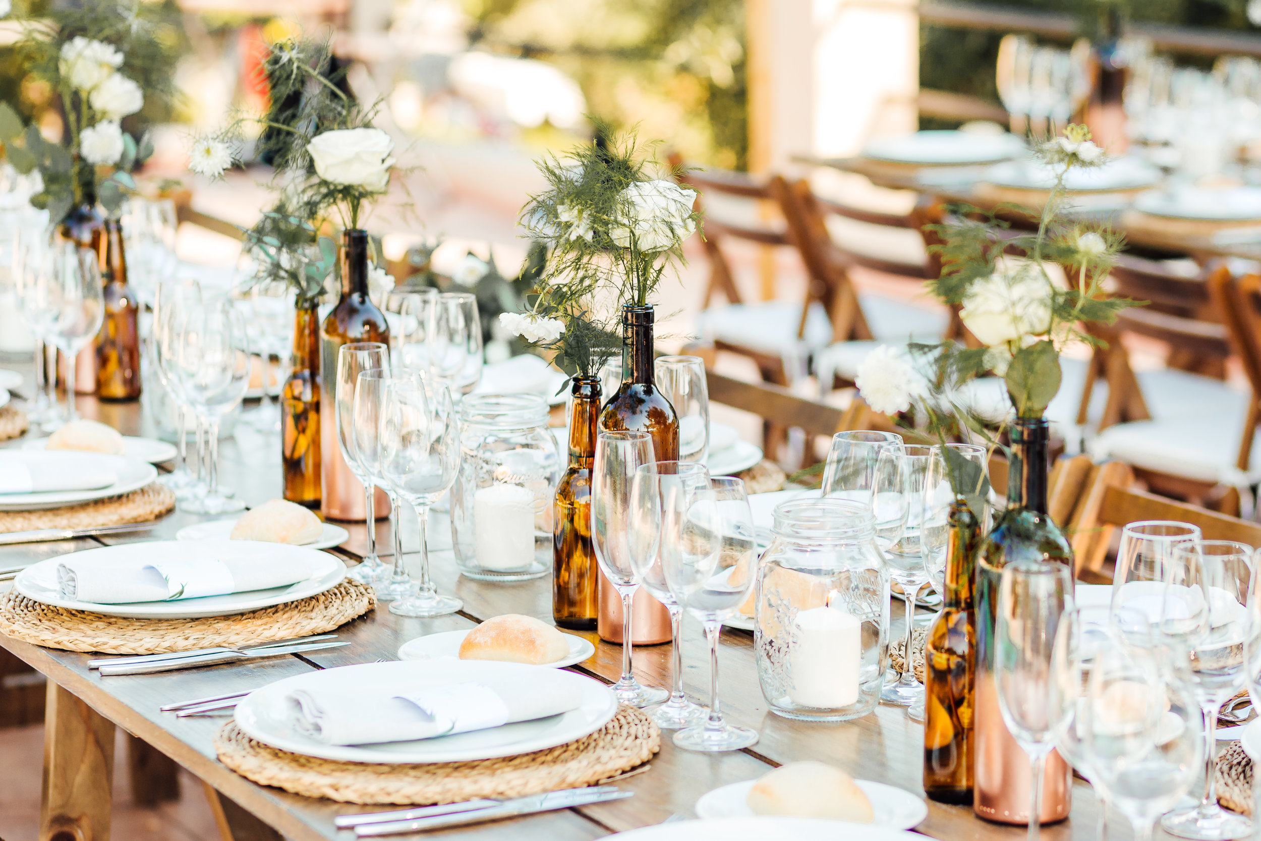 Love these up cycled bottles for wedding table decor - by pip at philippa events at the very cute Masa Santo in Cunit