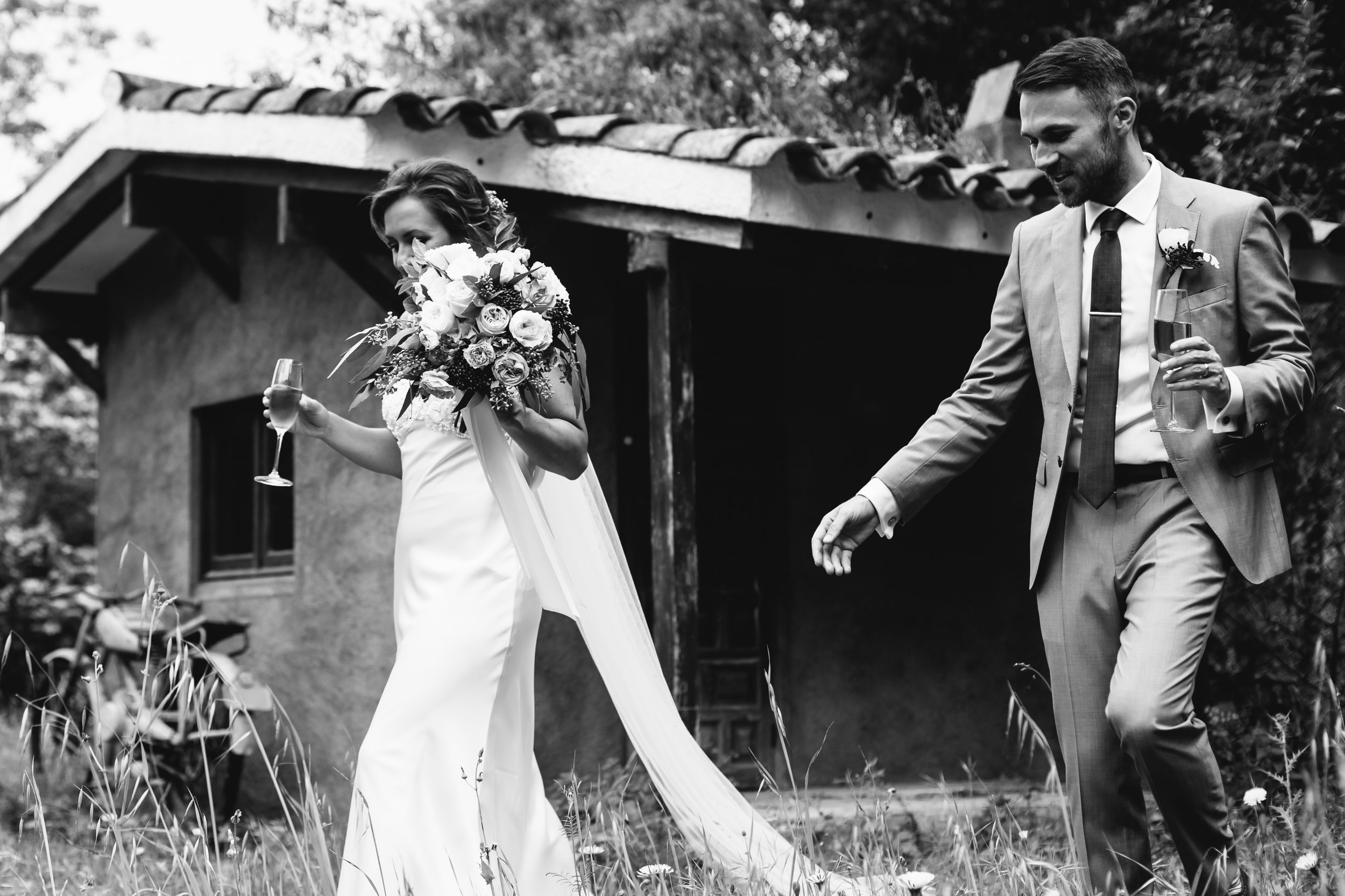 A bride and groom outside on their wedding day at Villa Catalina, Sant Pere de Ribes, Sitges, Barcelona with a bouquet of flowers photographed by Jo Kemp Photography