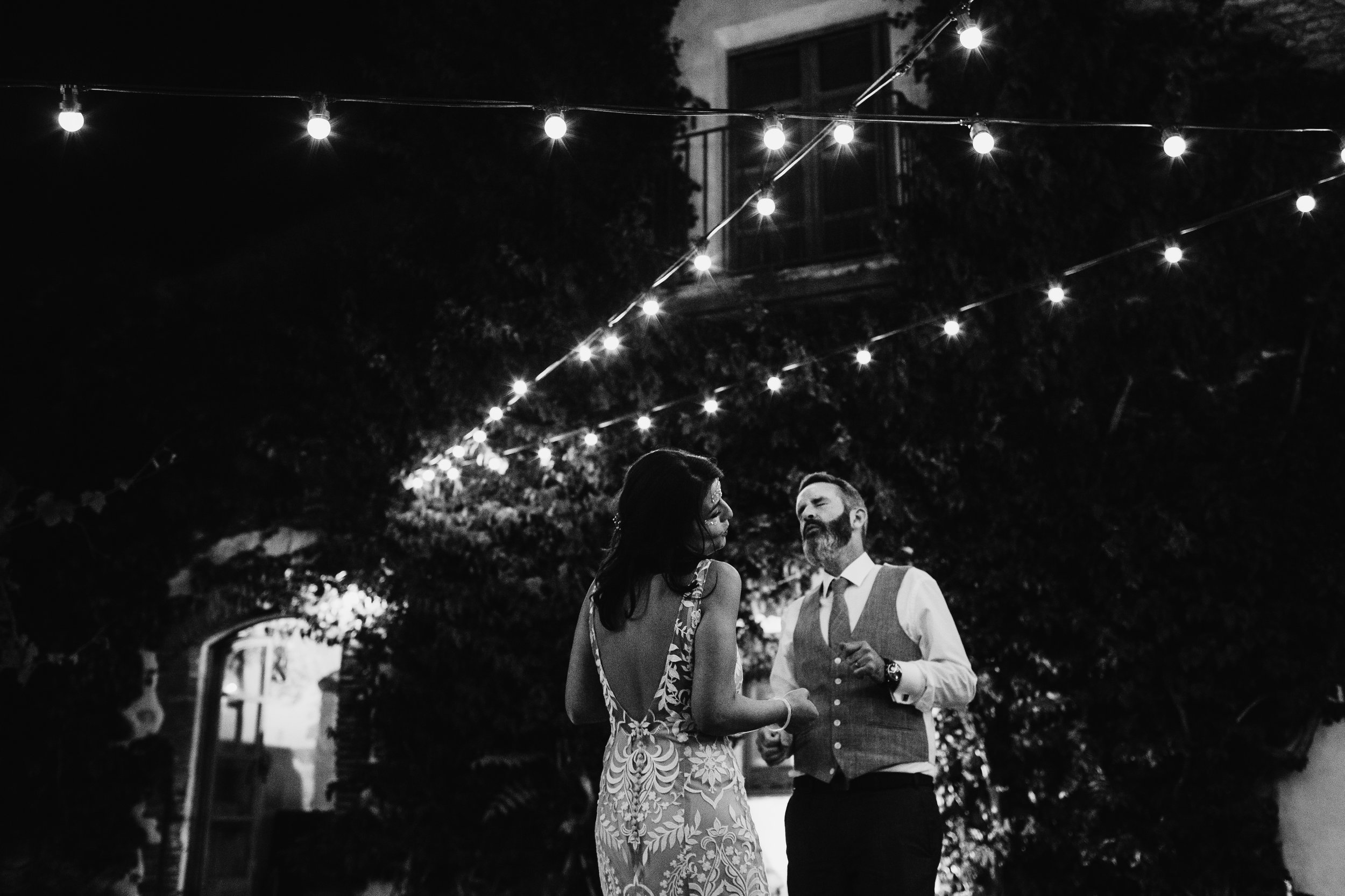 A bride and groom dancing on the night of their wedding at Almiral de la Font, Sant Pere de Ribes, Sitges, Barcelona by Jo Kemp Photography