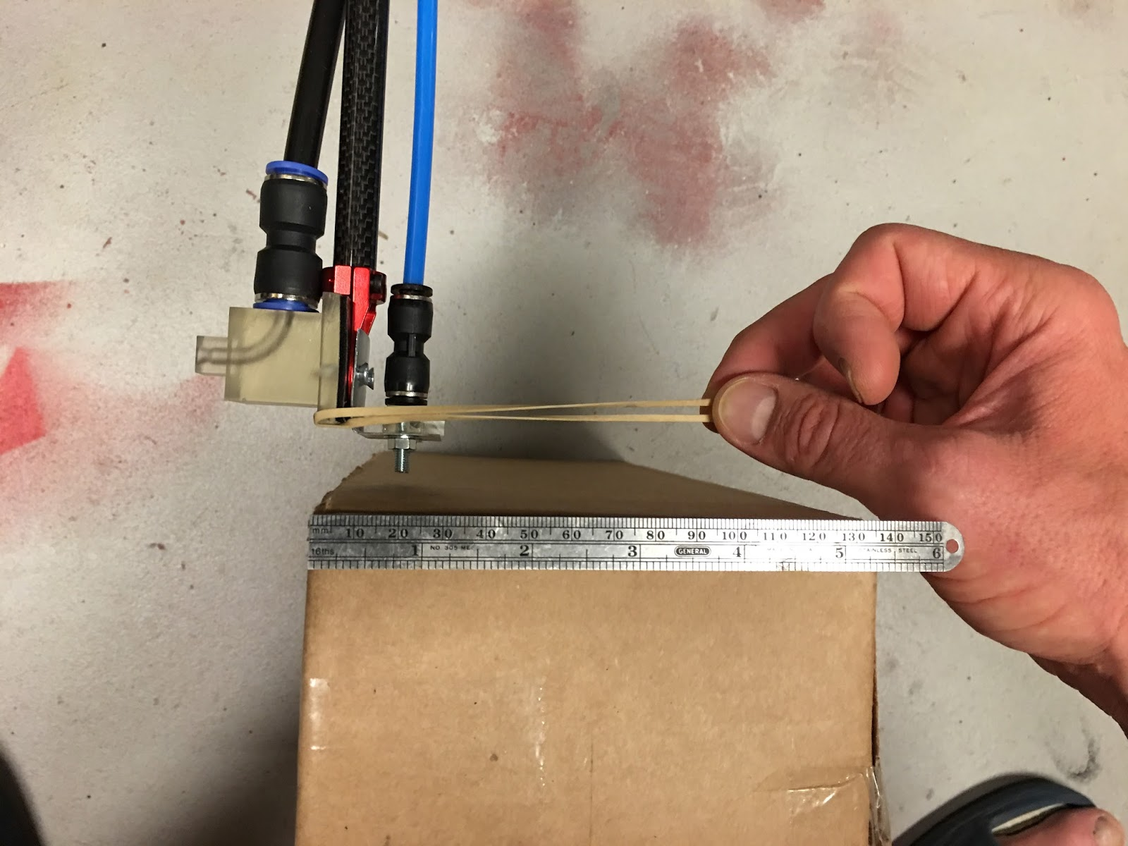 The HAPP project utilizes only the most sophisticated technologies: Cardboard box, millimeter scale, and an old rubber band. Nozzle v6 points left and v3 points right.