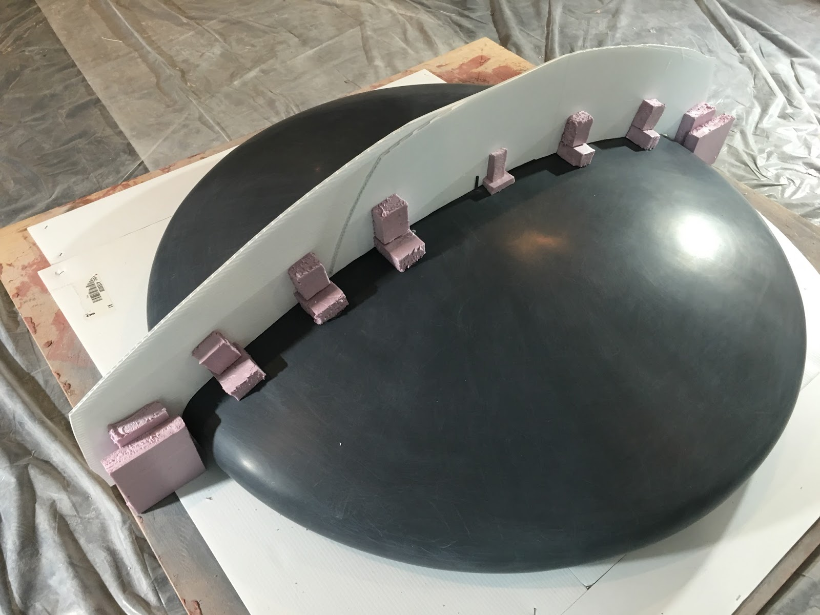 First half of mold to be formed on side opposite from the pink styrofoam
