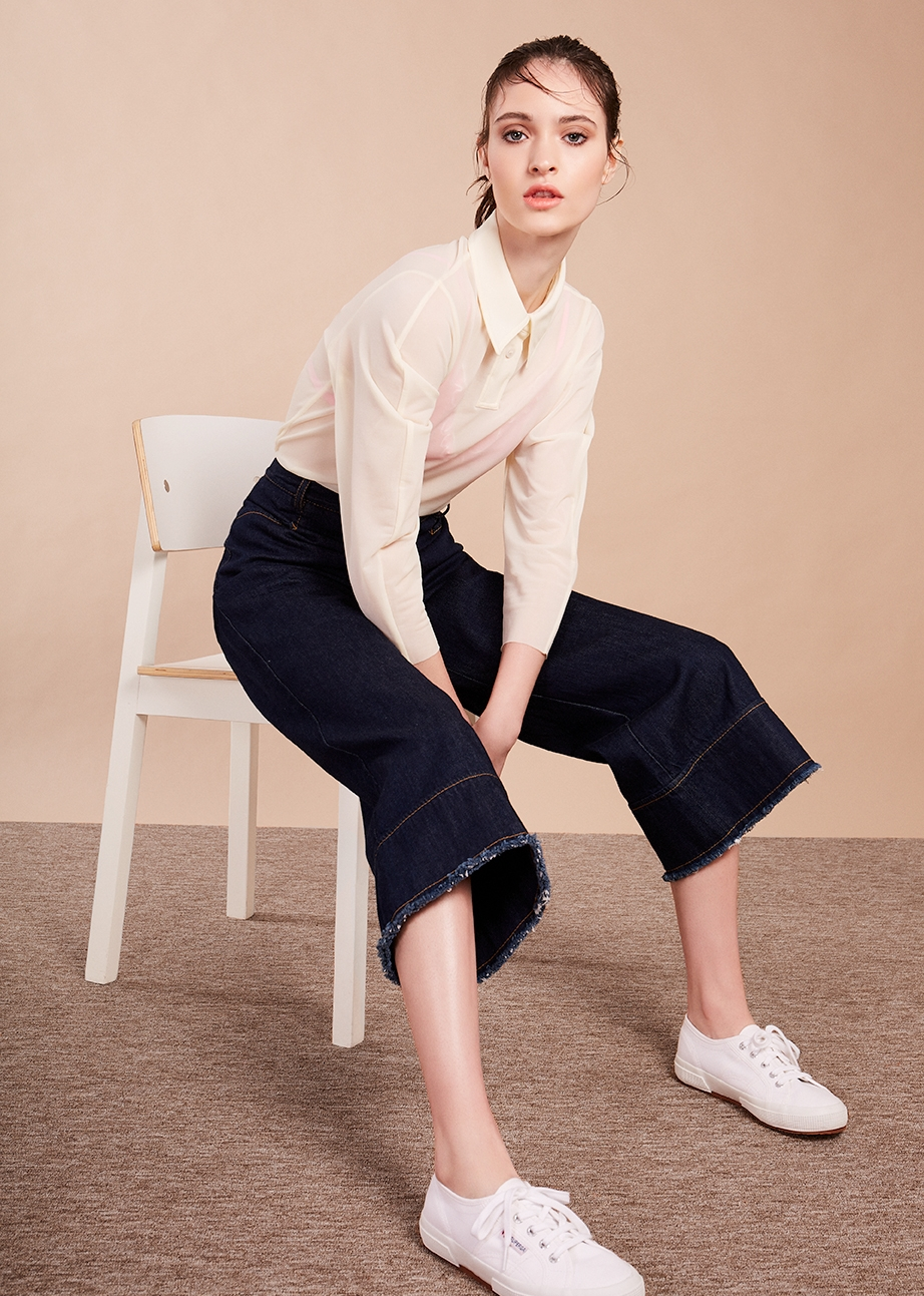 4. - Classic long sleeve polo top, £59, Cos; Pink mesh triangle bra (just seen), £17, Urban Outfitters; Karen Walker jeans, £215, Found Bath; White trainers, £50, Superga