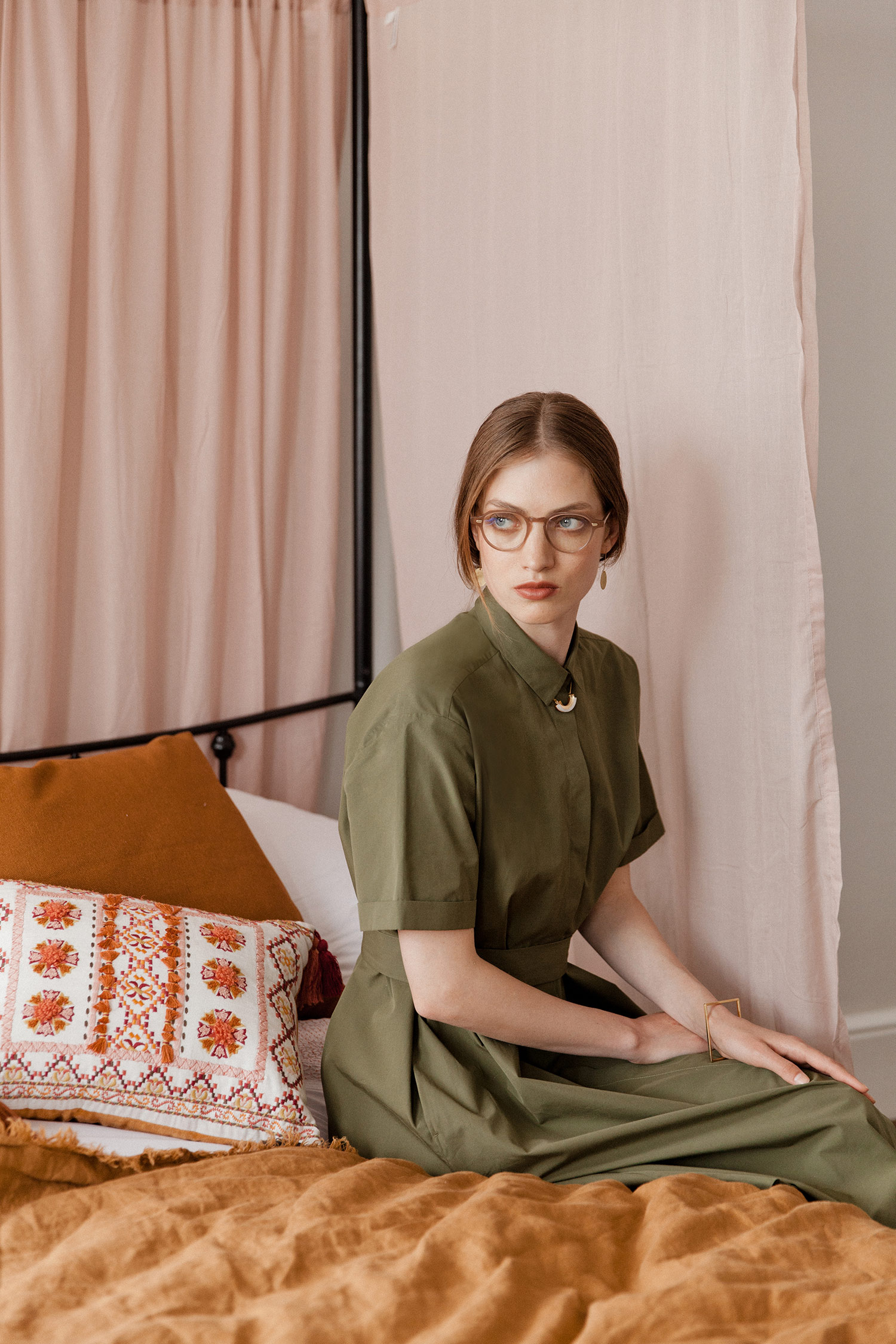 YMC Joan Dress olive, £225, Found; Pink crescent acrylic/wood necklace by Wolf & Moon, £28, Quadri; No.25 earrings, £35, Alice Bosc; Square sterling silver/yellow gold vermeil bangle by Anuka, £168, Quadri; Frames (model 1313) in Humble Potato, £285, Cutler and Gross