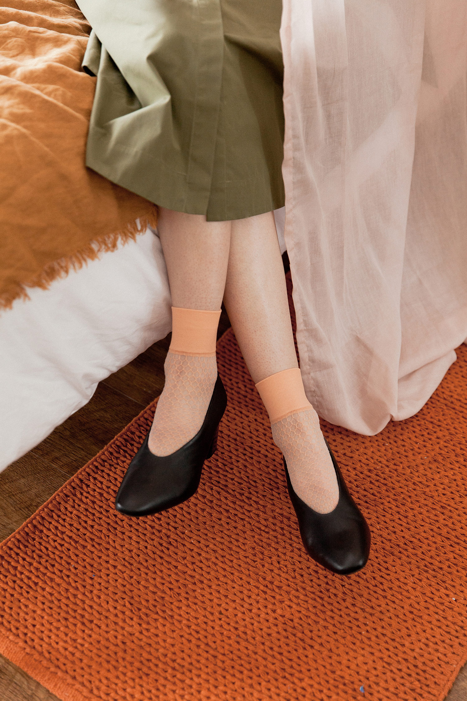 Pink net socks, £9.99 set of two, SockShop; Black leather block heel court shoe, £55, M&S