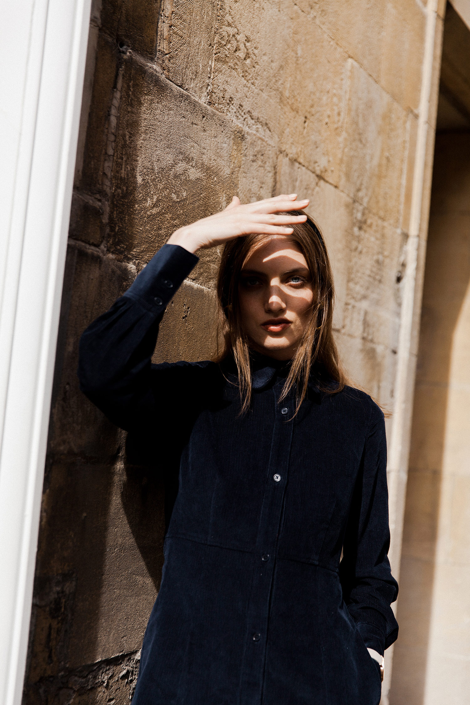 Cord shirt dress in dark navy, £160, Toast; Ruota hoop earrings by Laura Lombardi, £165, Found; Rose gold watch with marble face by CLUSE, £119.95, Quadri; Black velvet ribbon, as before