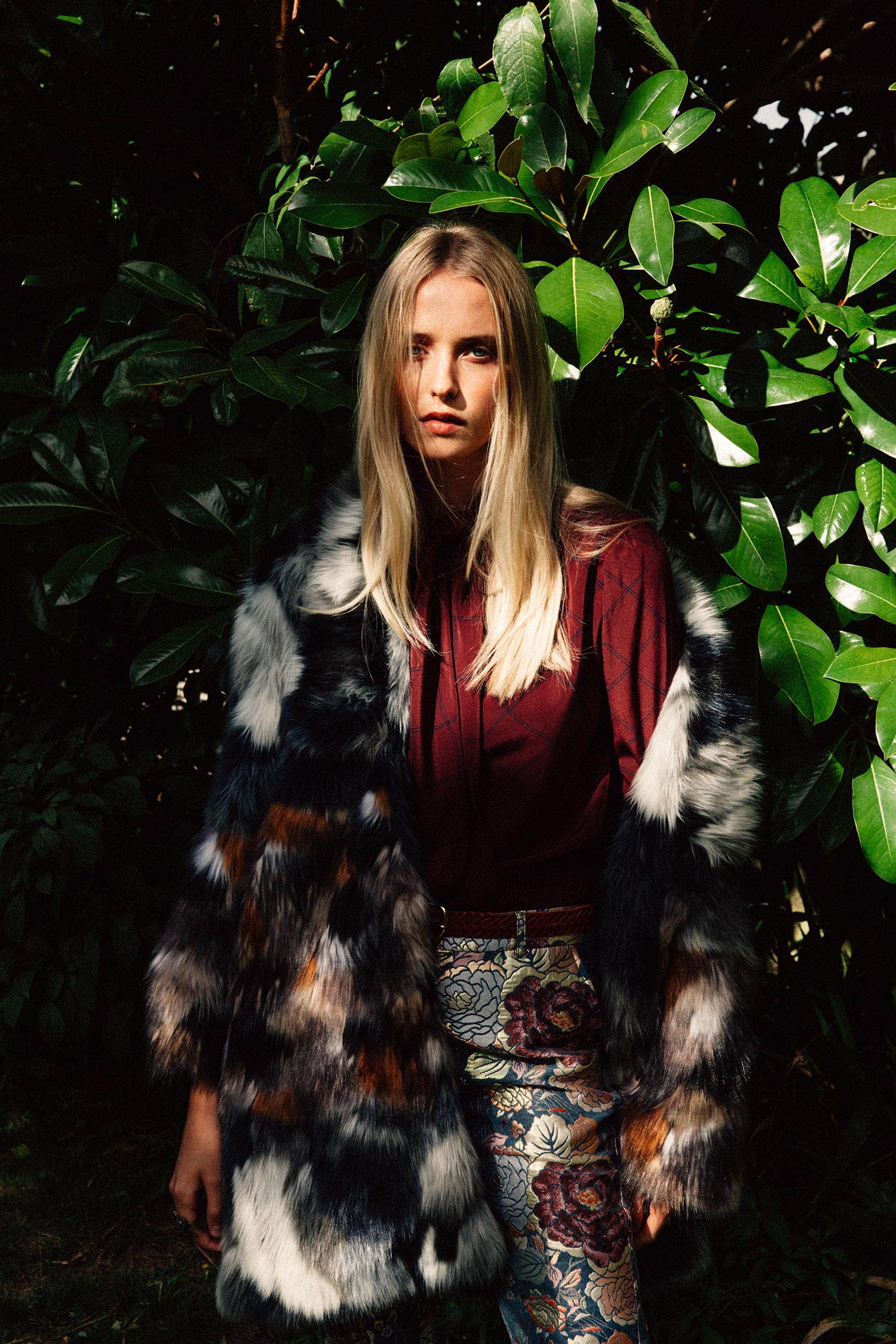 Golda faux fur coat, £190,  French Connection ; tie neck blouse, £20, and tan leather weave belt, £15, both  Rhubarb Jumble ; floral jacquard trouser, £210,  Custommade